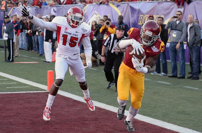 LAS VEGAS, NV - DECEMBER 21:  Josh Shaw #6 of the USC Trojans intercepts a pass in the end zone that was intended for Davante Adams #15 of the Fresno State Bulldogs during the Royal Purple Las Vegas Bowl at Sam Boyd Stadium on December 21, 2013 in Las Vegas, Nevada. USC won 45-20.  (Photo by Ethan Miller/Getty Images)