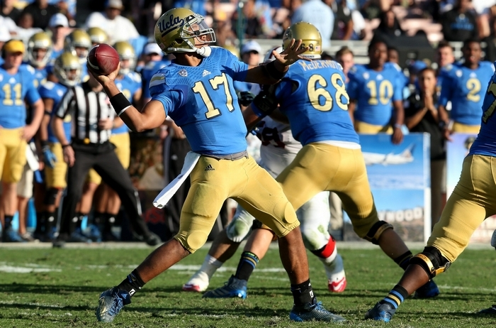 UCLA quarterback Brett Hundley, the school's all-time leader with 75 passing touchdowns and 11,677 total yards, is rated below average in pocket awareness and in reading defenses. (Getty Images)