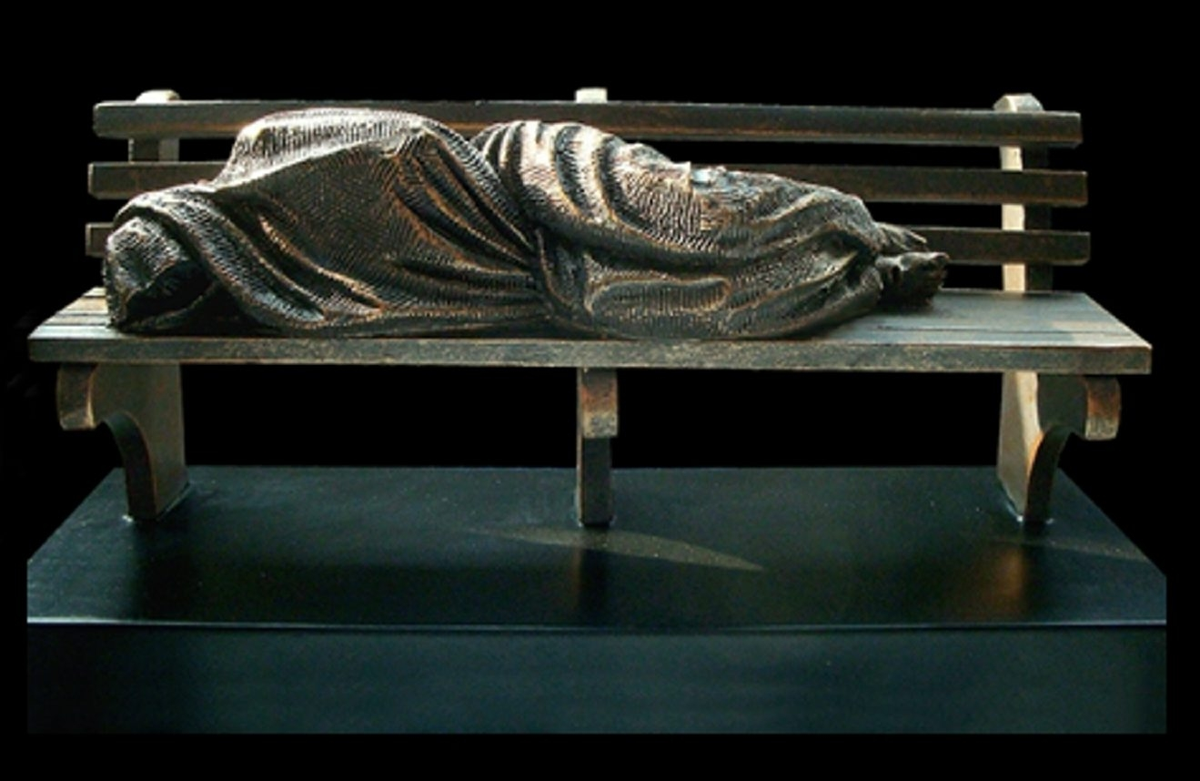 """Homeless Jesus,"" a controversial statue by Canadian artist Timothy J. Schmalz, was installed in Buffalo's Cathedral Park on Monday."