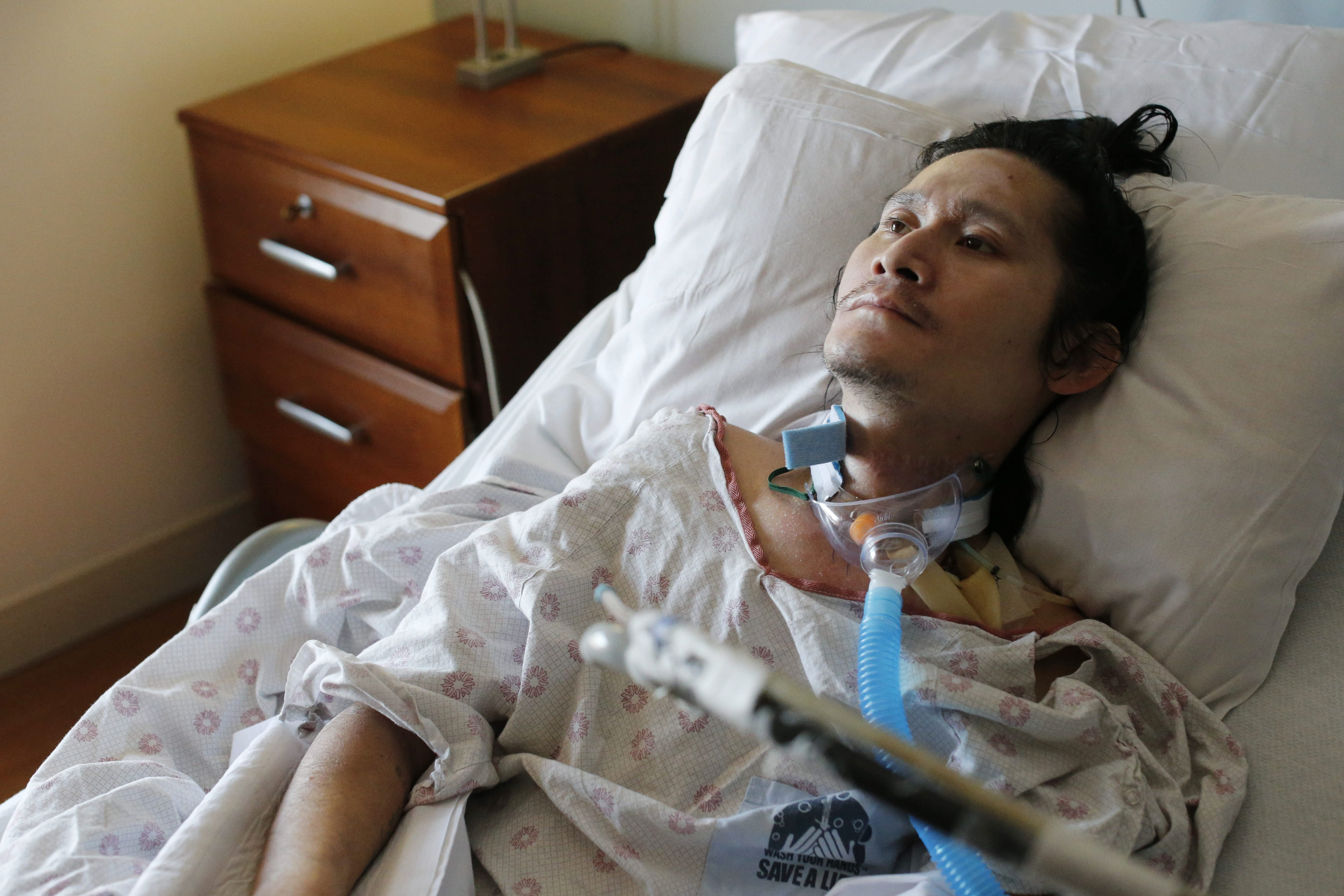 K'Paw Wah, an immigrant from Burma who is paralyzed after being beaten in a robbery/assault on the West Side last June, rests in his bed Saturday at the Terrace View Nursing Home.