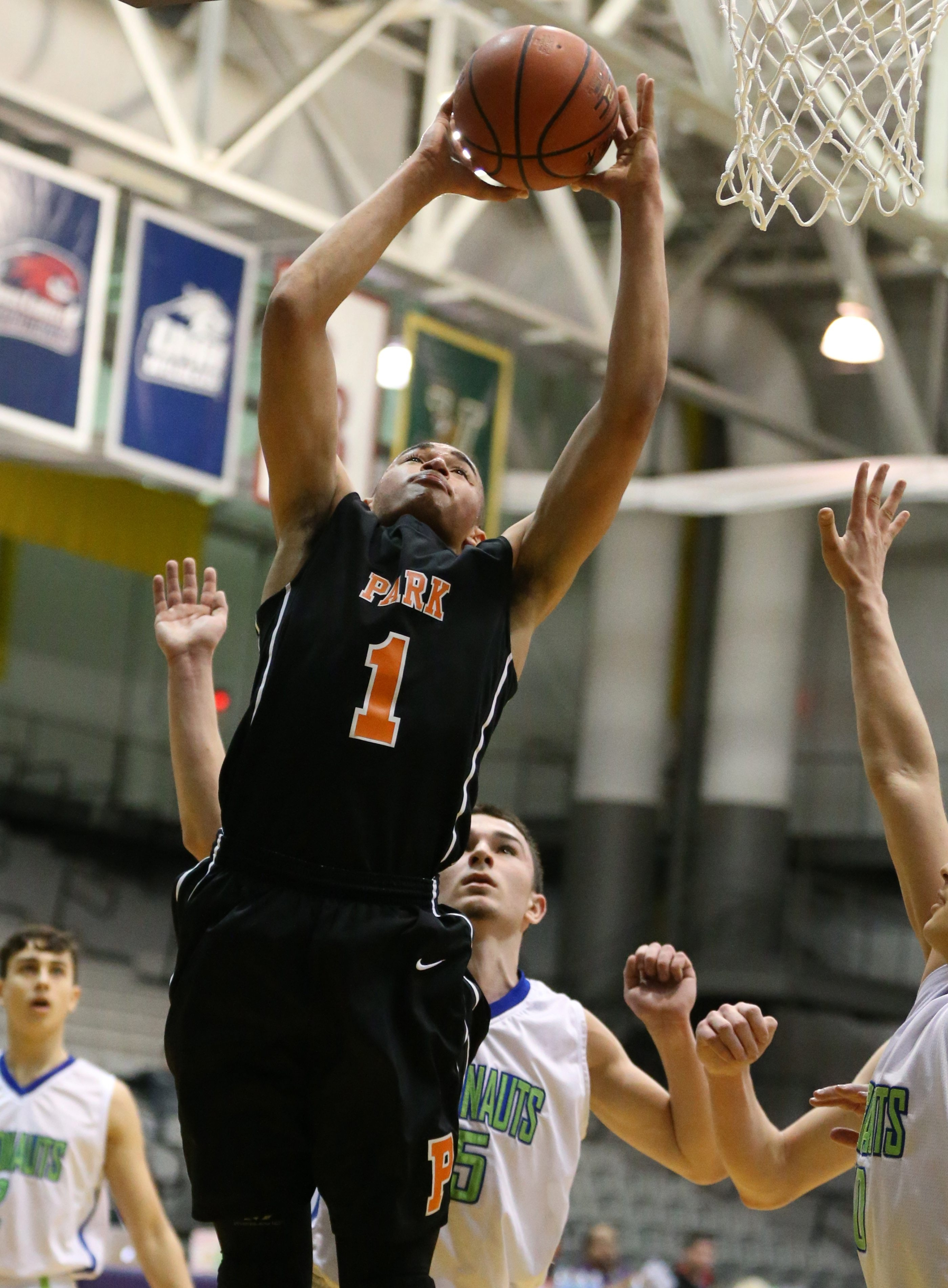 Park School senior Randy Golda goes up strong to score two points over Maspeth's Paolo Tamer in the first quarter. Park won the Federation Class B championship with a 70-51 victory.