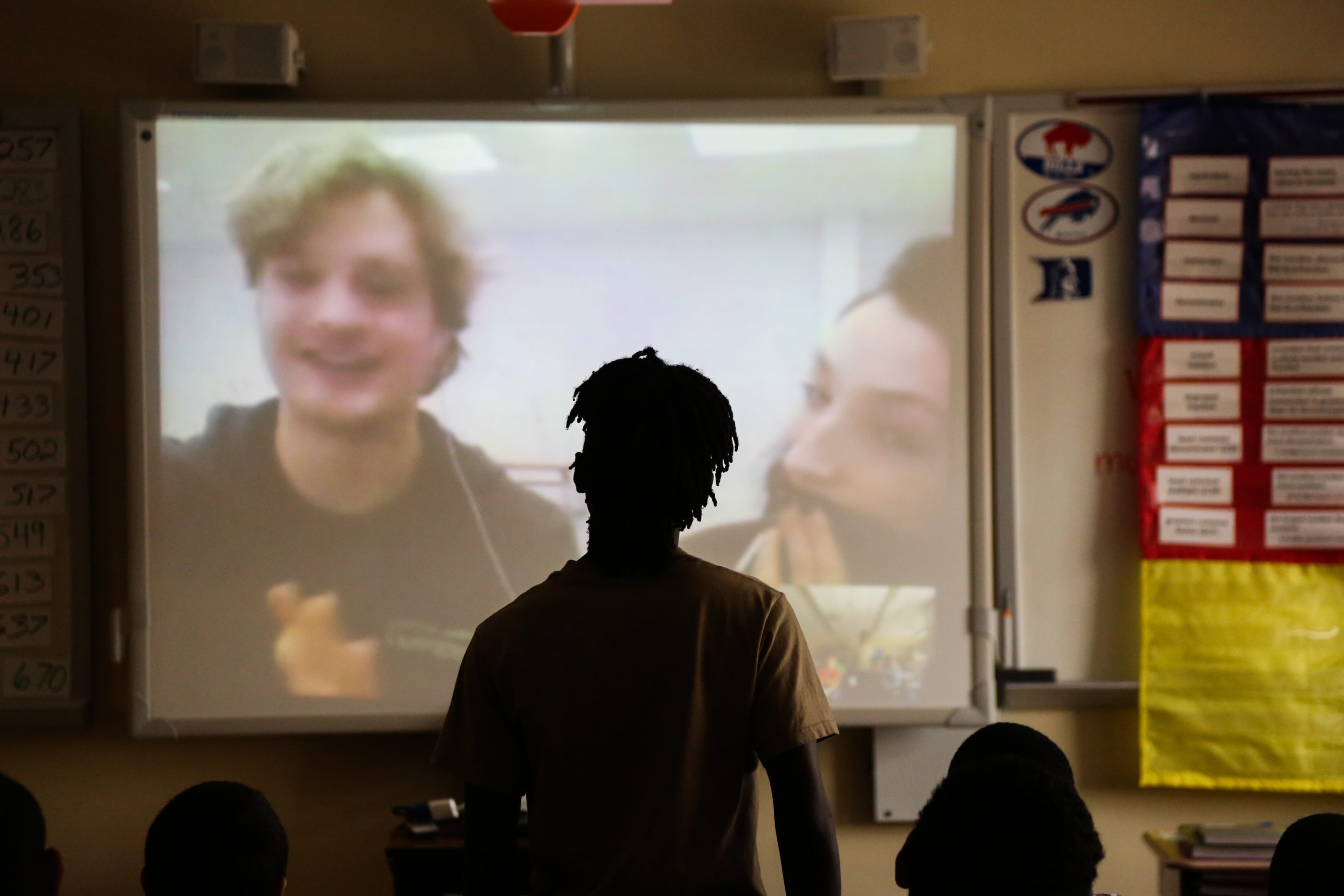 A student chats with Olympians Charlie White and Meryl Davis in Classroom Champions at Houghton Academy.