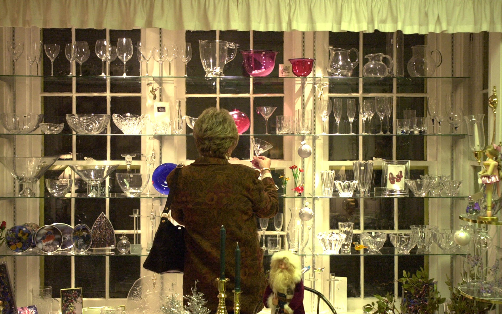 A shopper checks glassware at the Lemon Tree, one of the Orchard Park businesses due to close.