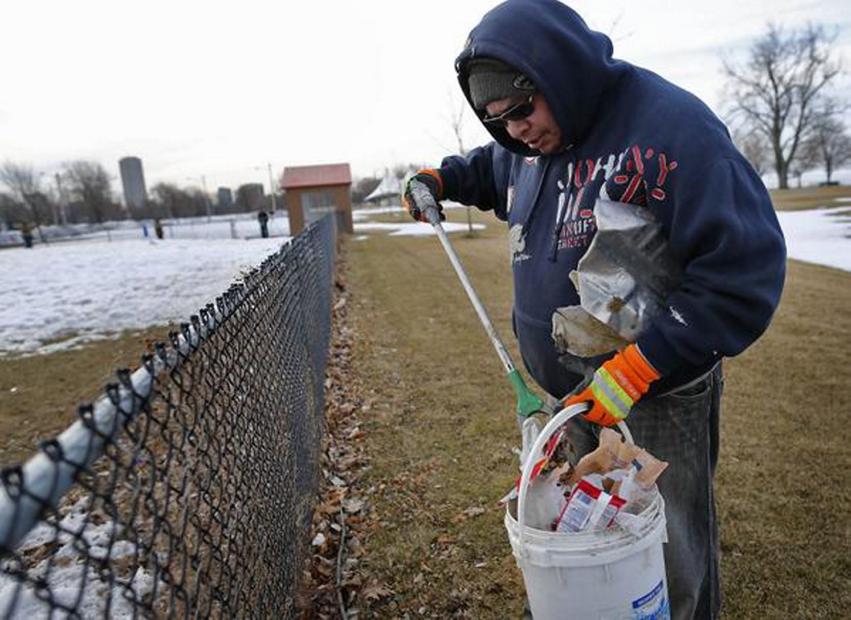Parks worker Robert Williams picks up trash in LaSalle Park as the city begins annual spring cleanup on Wednesday, March 25, 2015.  (Derek Gee/Buffalo News