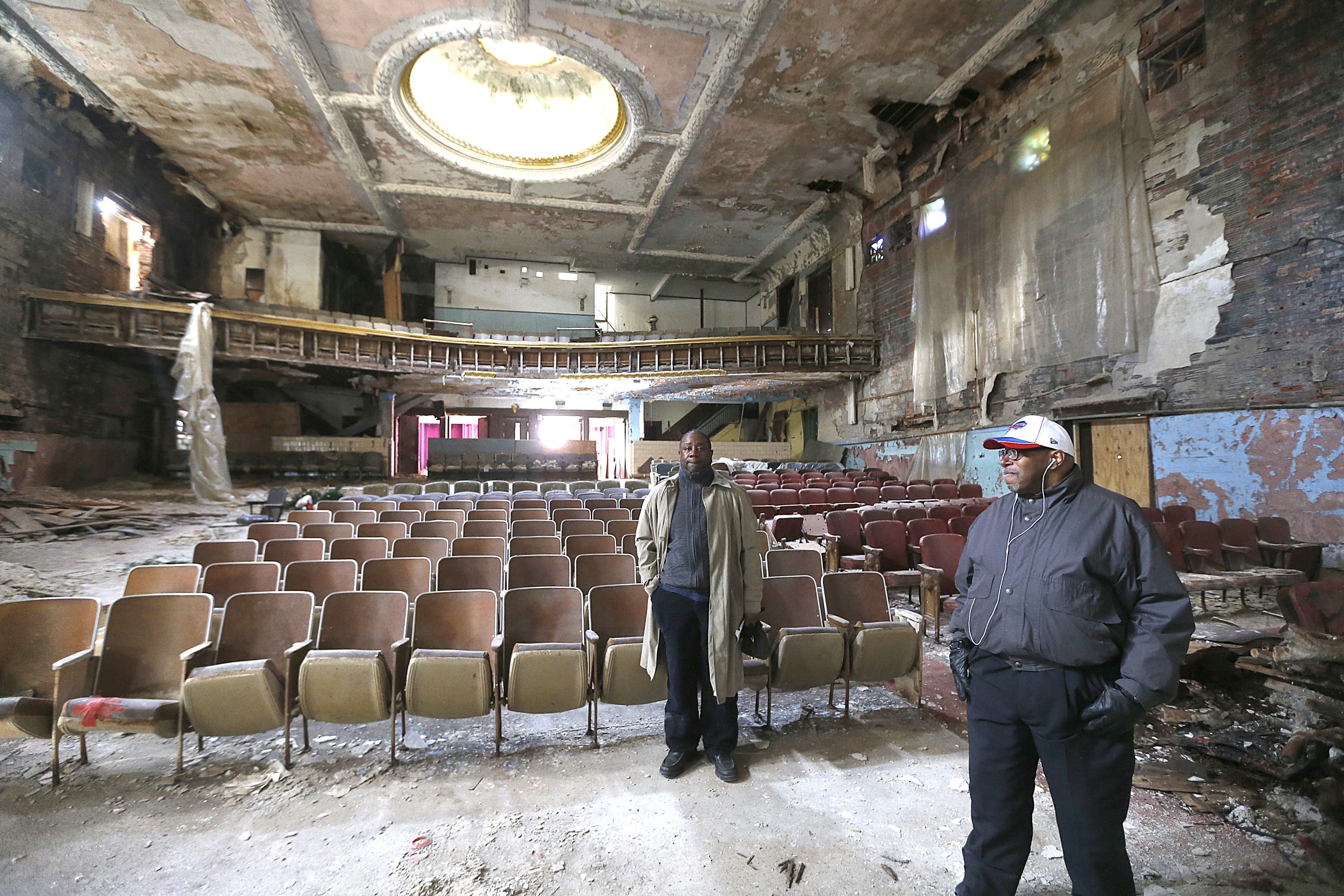 Dwayne Kelly, right, and Michael Quinniey think the old and crumbling Broadway Theatre on Broadway can and should be restored to its former glory.