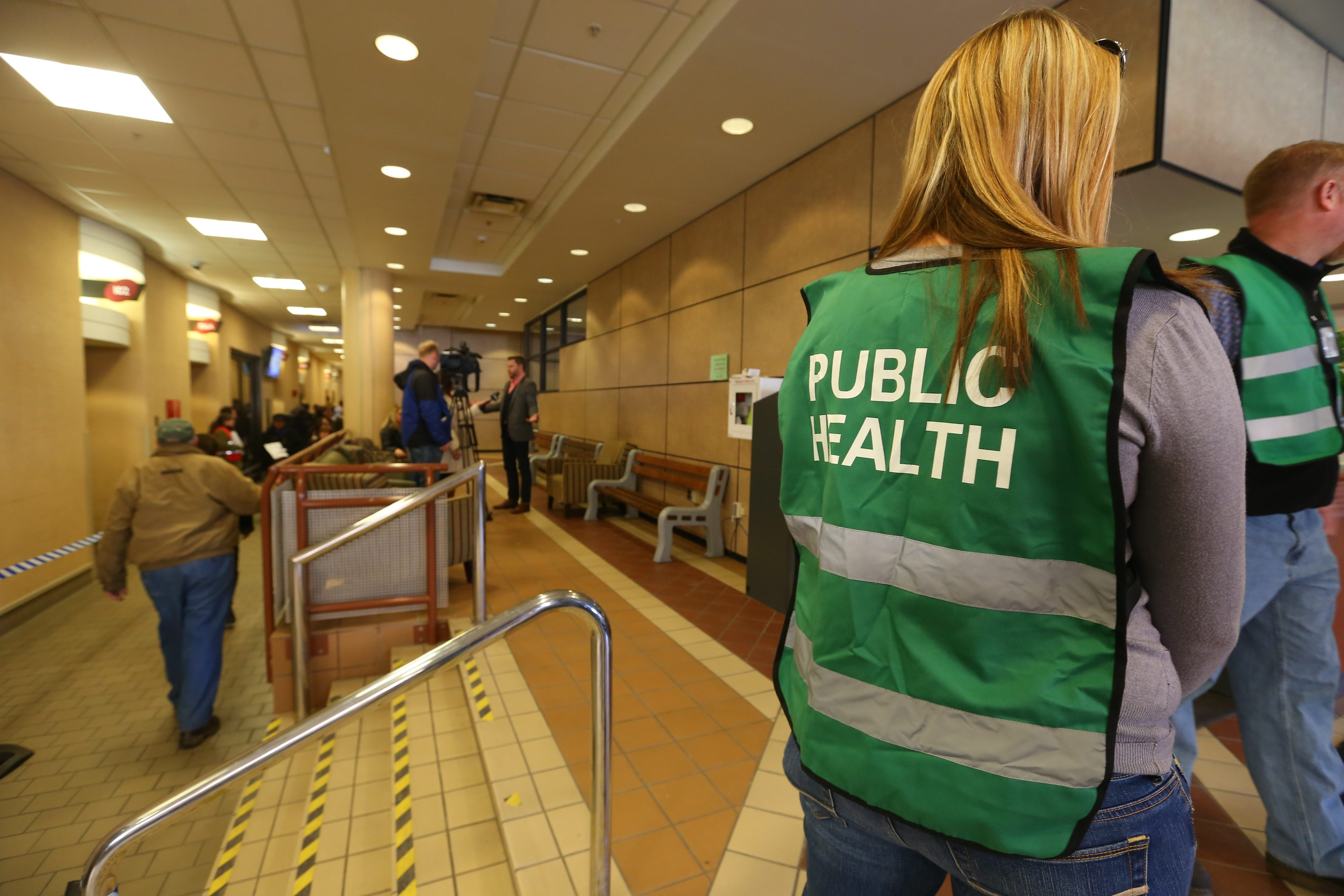 Erie County Health Department workers greet people as they file into get vaccinated for hepatitis A at the Buffalo Niagara Convention Center in Buffalo Monday, March 24, 2015.    (Mark Mulville/Buffalo News)