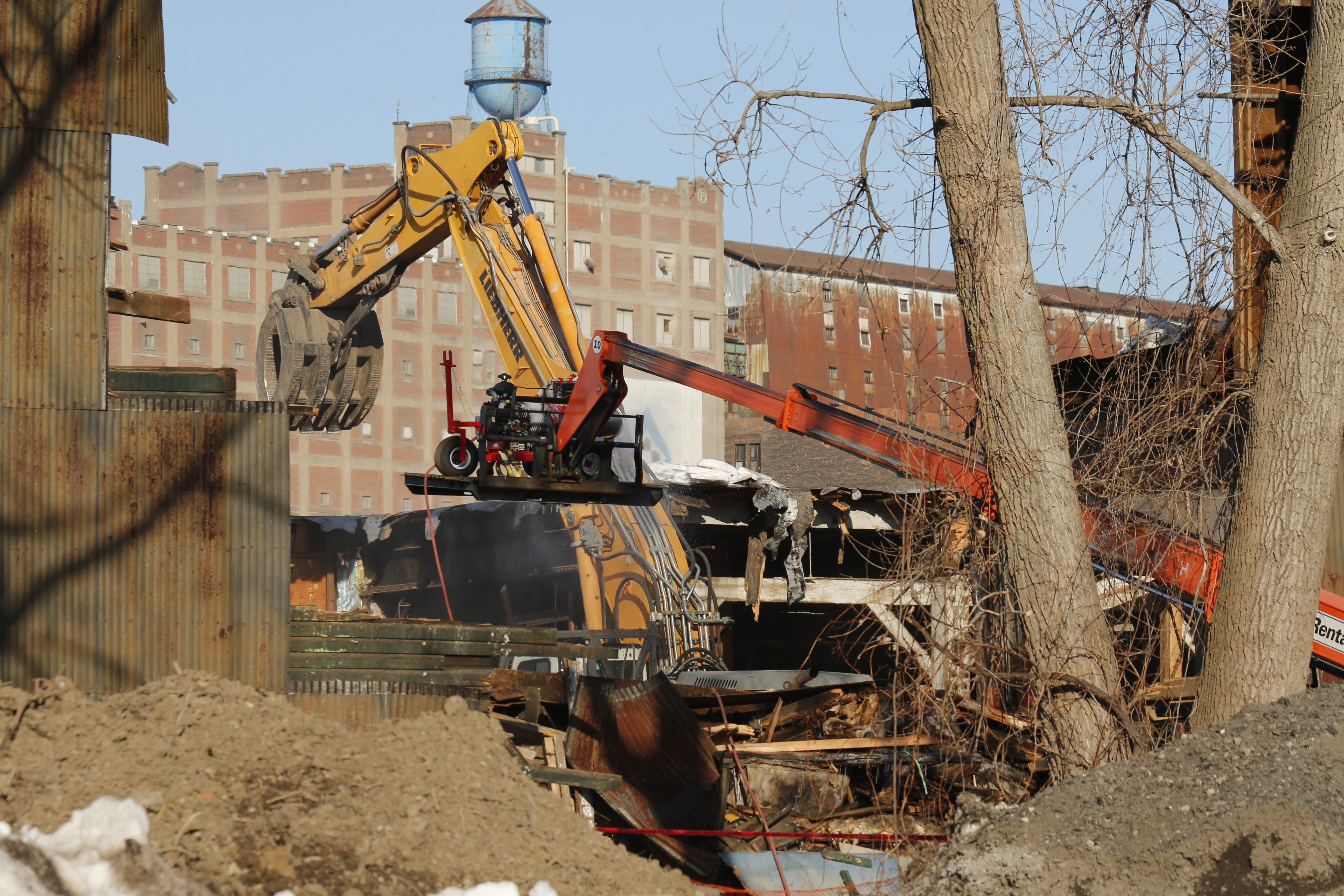Demolition crews take down the deteriorating former Erie Freight House on Ohio Street on Monday. Within a year, the old industrial site will be home to the Buffalo River Landing luxury apartment complex, the newest trendy address for city residents.