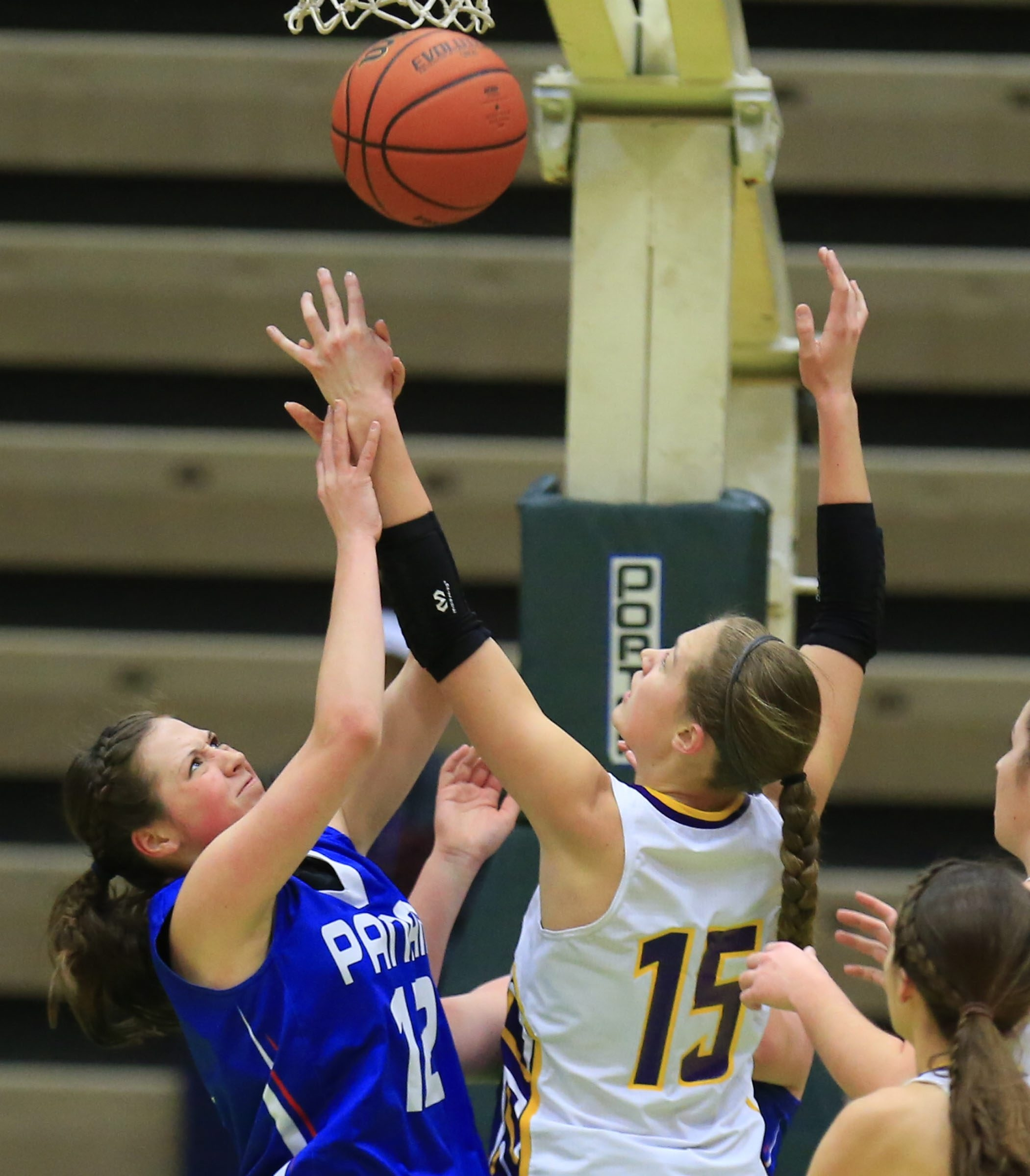 2LINE CUTLINE Panama's Brittany Lenart and Heuvelton Central's Paige mccormick battle for a rebound during the first half of the New York State  Class D  semi-final in the 2015 NYSPHSAA Girls Basketball Championships at Hudson Valley Community College on Saturday, March 21, 2015.(Harry Scull Jr./Buffalo News)