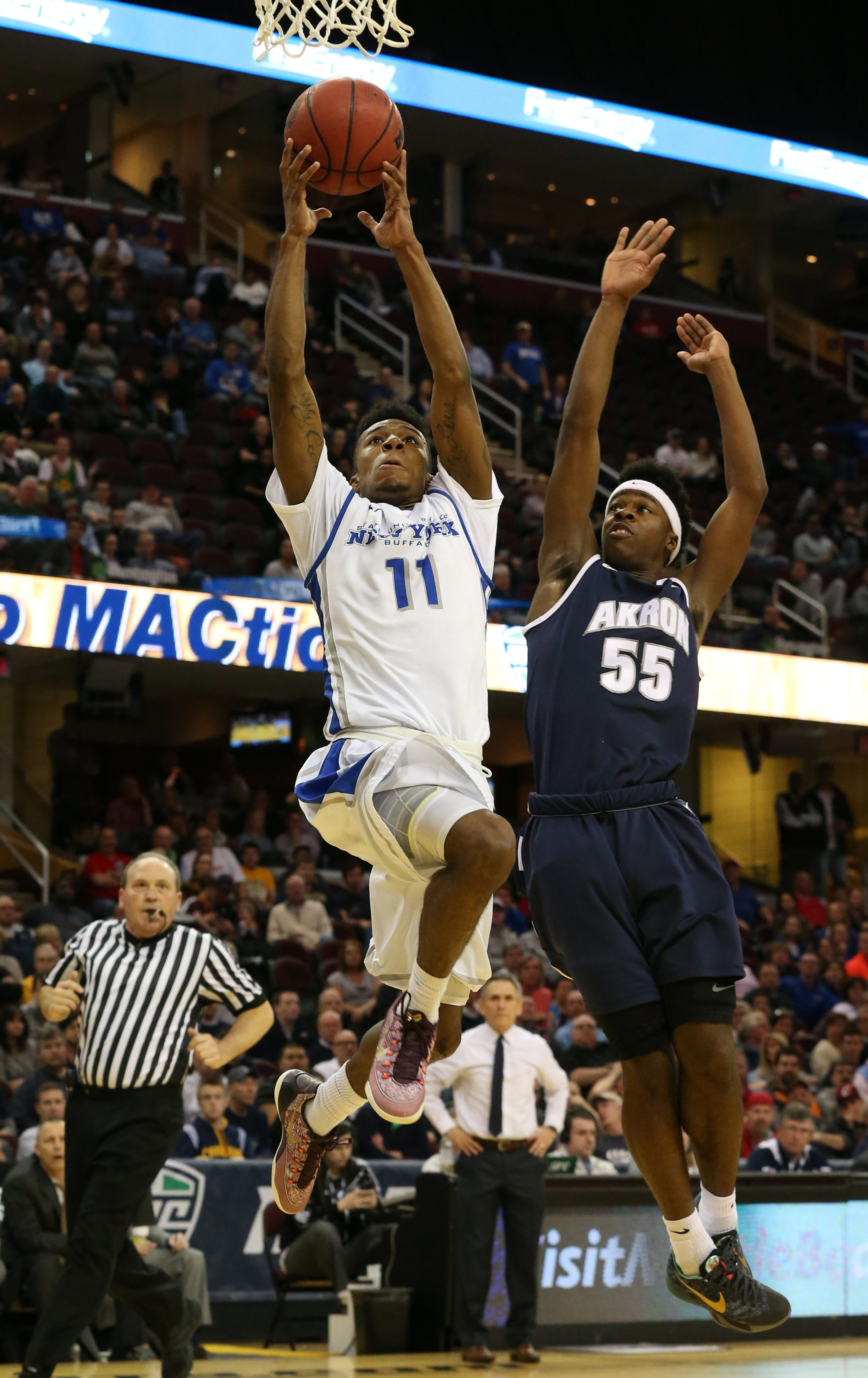 2 lien cut Buffalo Bulls guard Shannon Evans (11) scores two points over Akron Zips guard Antino Jackson (55) in the first half during the semifinals of the 2015 MAC Men's basketball Championship at Quicken Loans Arena in Cleveland,Ohio on Friday, March 13, 2015.  (