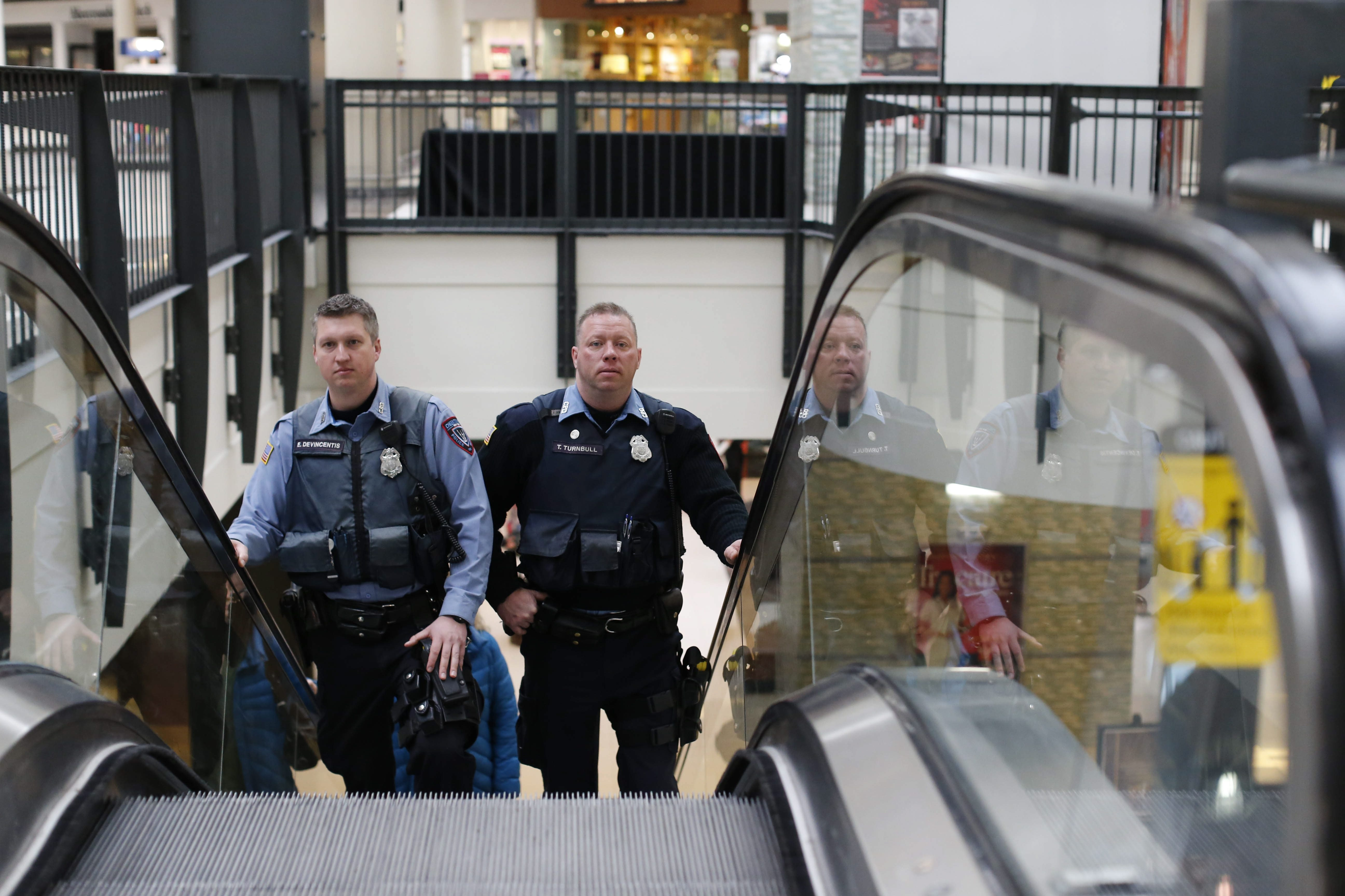 Cheektowaga Police Officers Emil F. DeVincentis, left, and Timothy A. Turnbull patrol inside the Walden Galleria mall in the town Friday. The town Police Department has briefed all of its officers on the terrorist video that urges extremists to target U.S. malls.