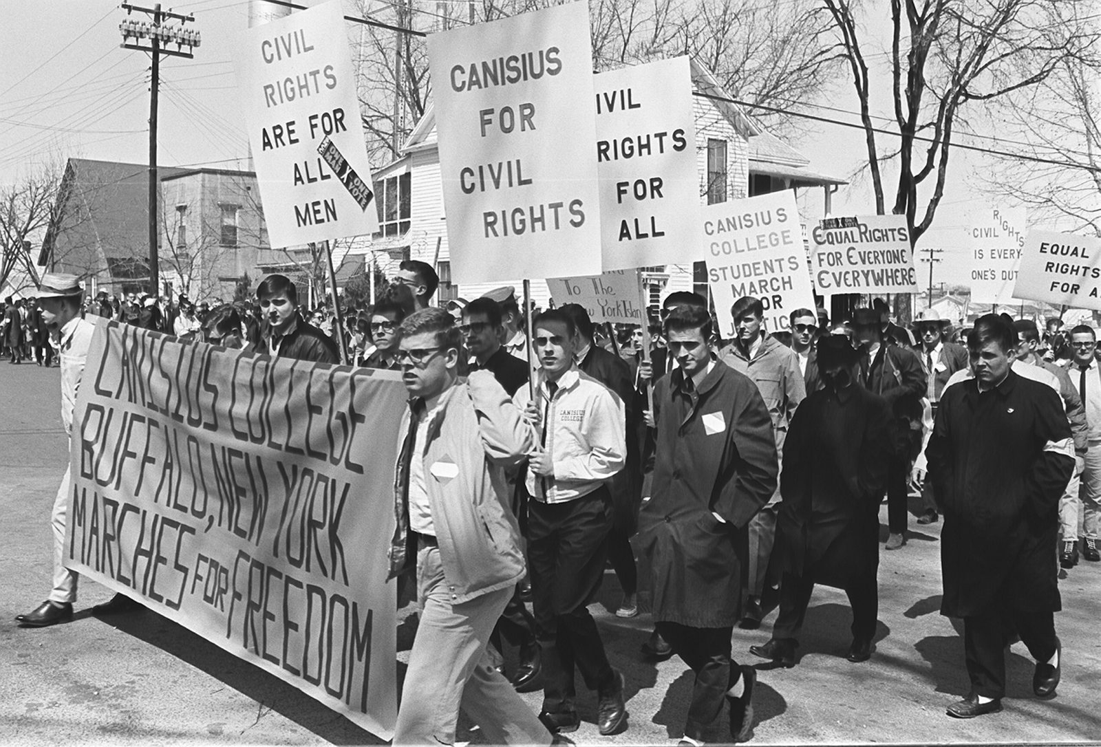 Canisius protesters carry placards during the 54-mile march from Selma to Montgomery, Ala., 50 years ago. (Photo by Lynn Ball/The Ottawa Citizen)