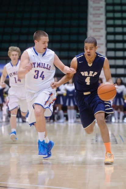 New York Mills' Griffin Baur and International Prep's Terrance James, who had 26 points in a losing effort, go head-to-head in the Class D NYSPHSAA Semifinal game.