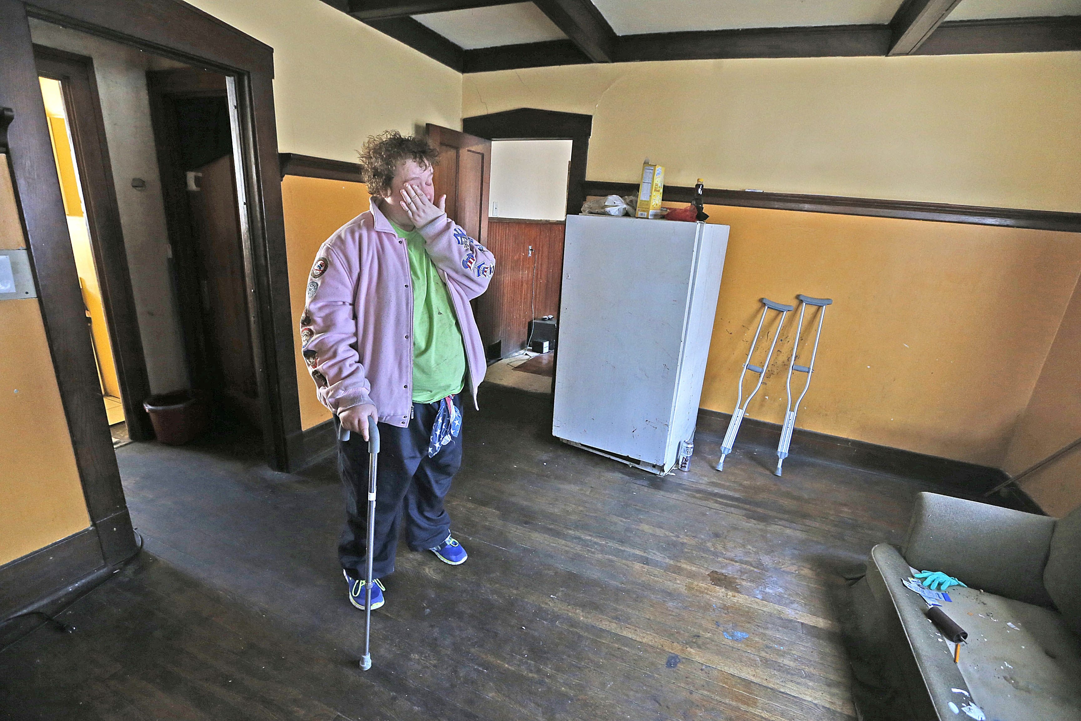 Debbie Ballard was living in deplorable conditions at 496 East Utica St. in Buffalo. She and the other seven residents have been moved out. (Robert Kirkham/Buffalo News)