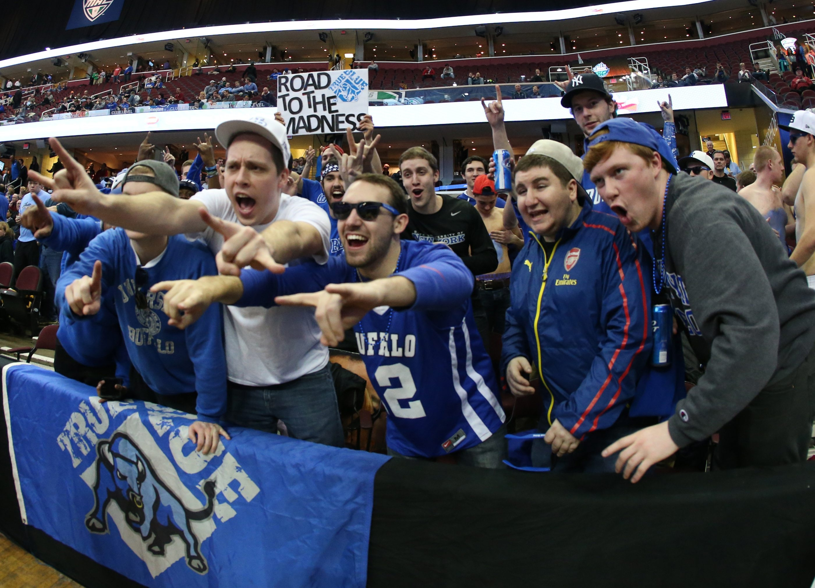 Buffalo Bulls fans greet the players as they enter the court. (James P. McCoy/ Buffalo News)