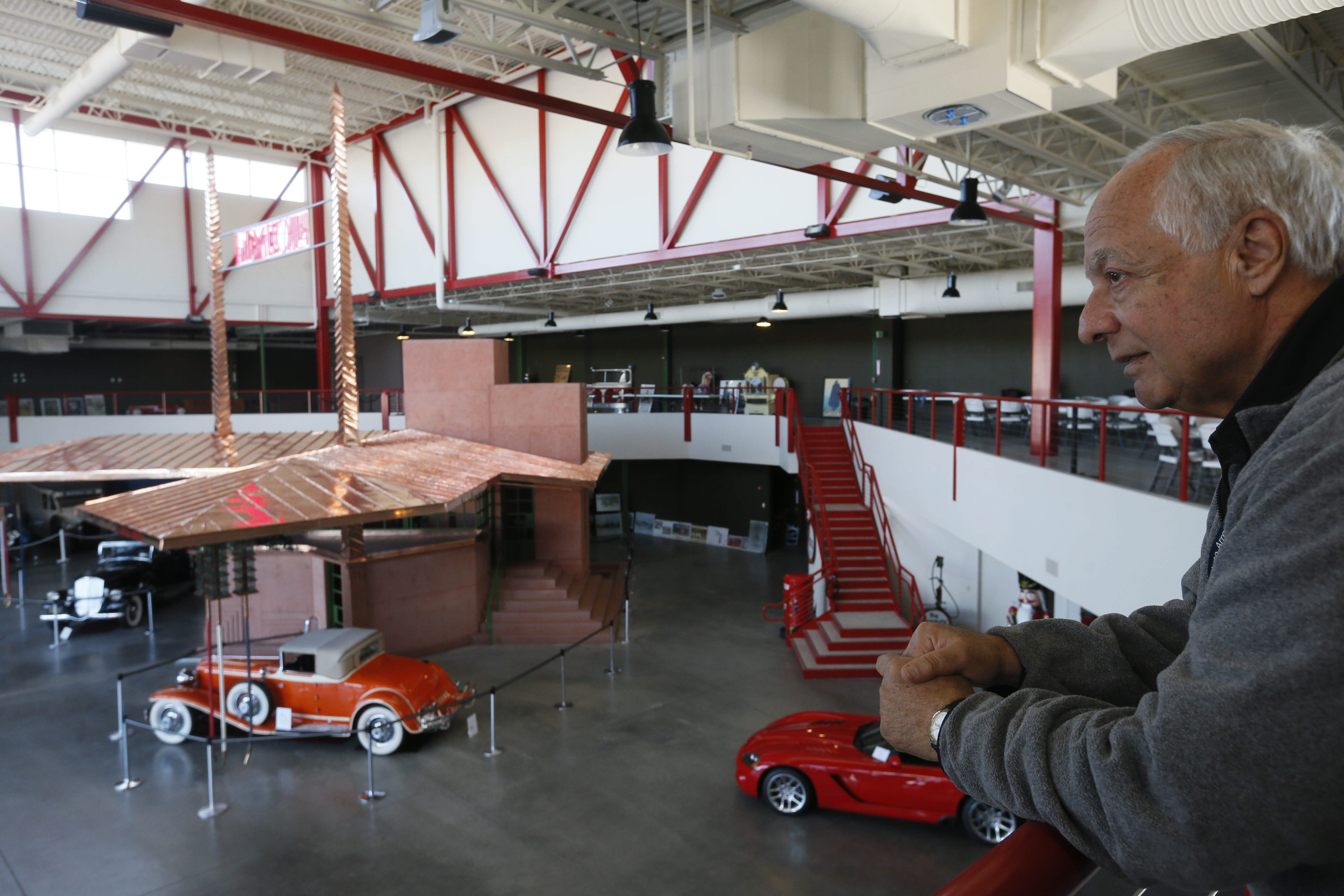 James Sandoro, who founded the Buffalo Transportation/Pierce-Arrow Museum downtown with his wife, Mary Ann, looks over the Frank Lloyd Wright Filling Station exhibit after their recent acquisition of adjacent property that will enable expansion to 300,000 square feet.