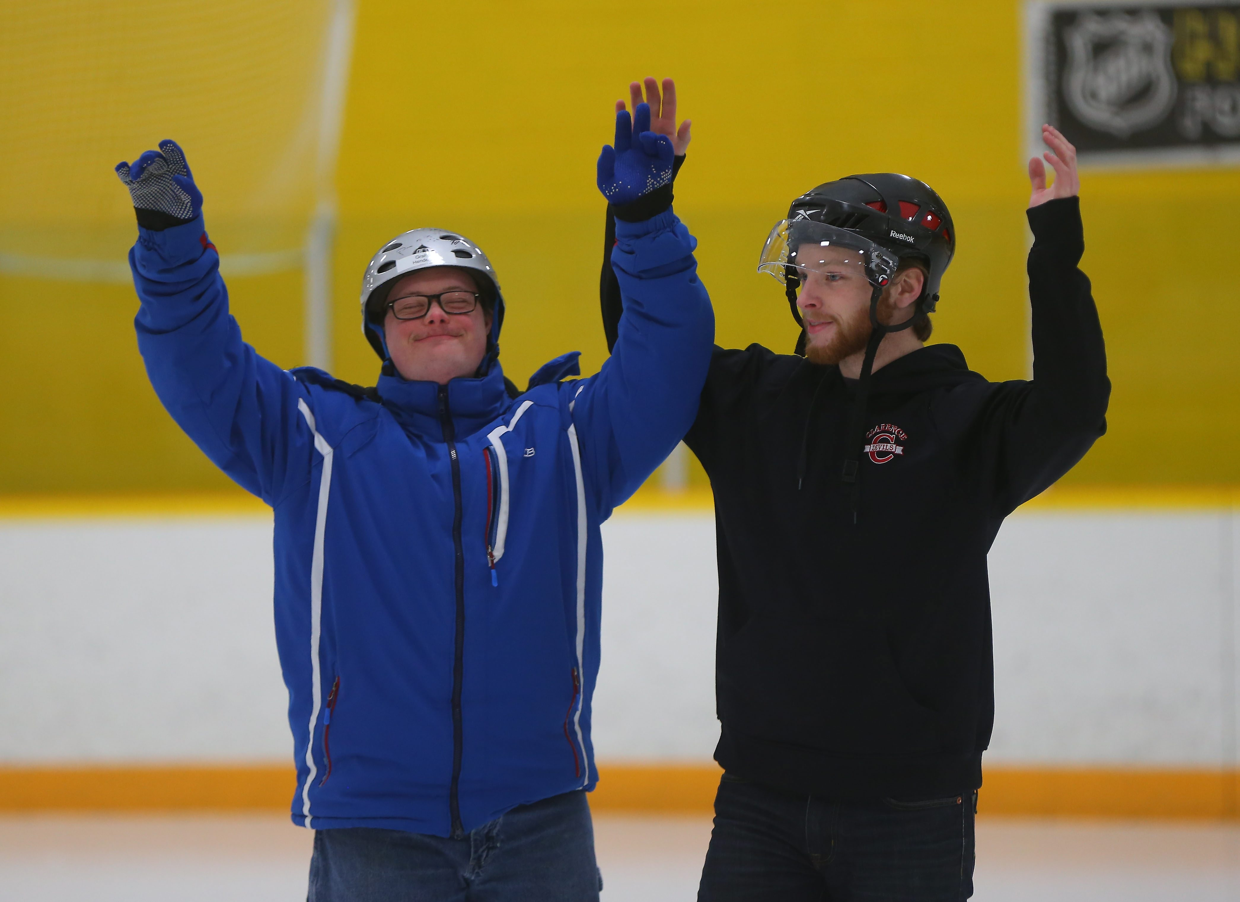 """Graham Henderson, left, and volunteer Brian Manley practice their bow at Riverside Rink in Buffalo on Tuesday. Henderson will be skating with Manley to the tune of Bruno Mars' """"Count on Me"""" at the ice show Sunday in First Niagara Center."""