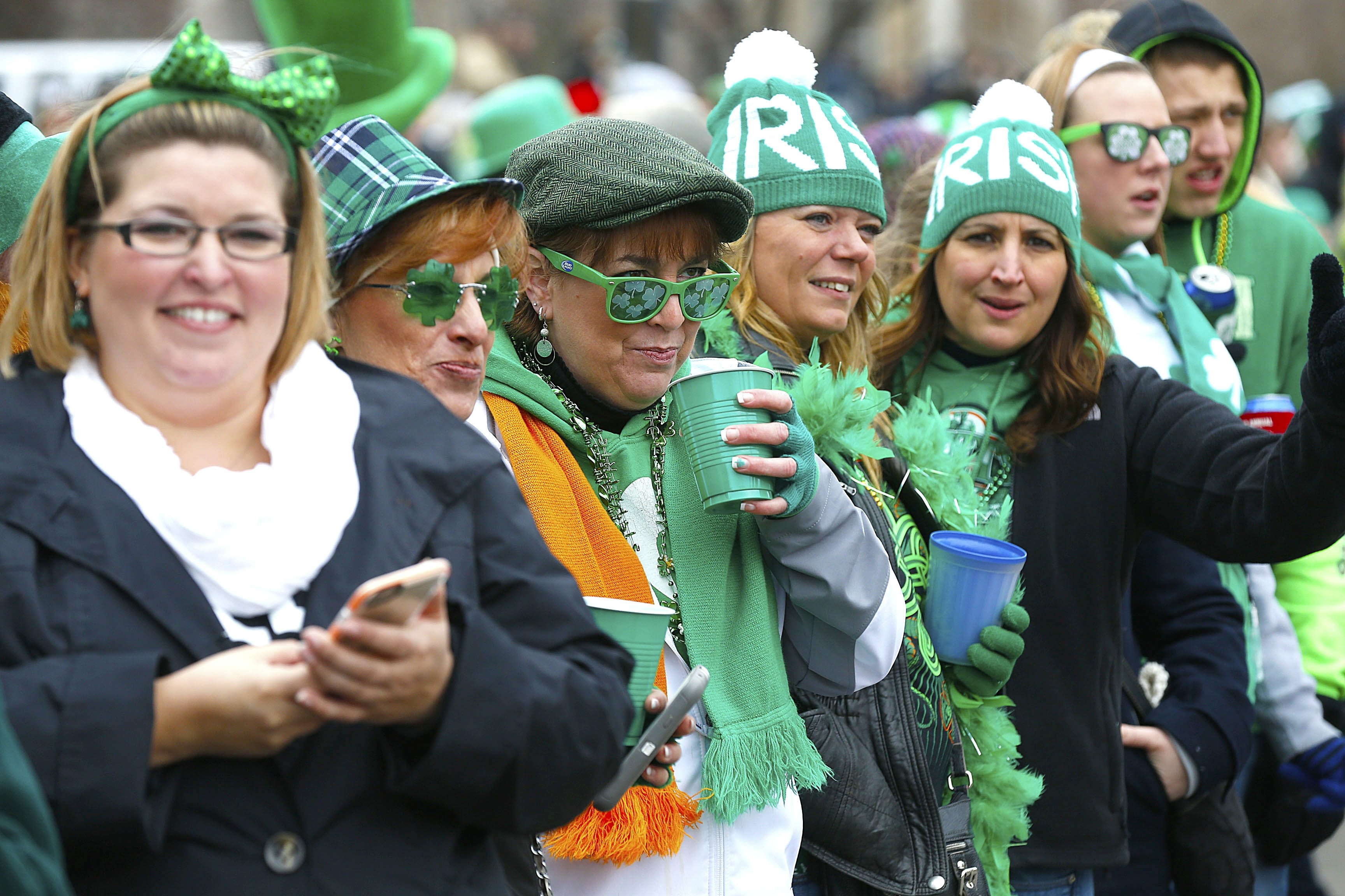 "Despite temperatures in the 30s and gusty winds, St. Patrick's Day Parade spectators brim with good cheer along Delaware Avenue in Buffalo. As one put it, ""It feels like the beginning of spring."" See a photo gallery at BuffaloNews.com."