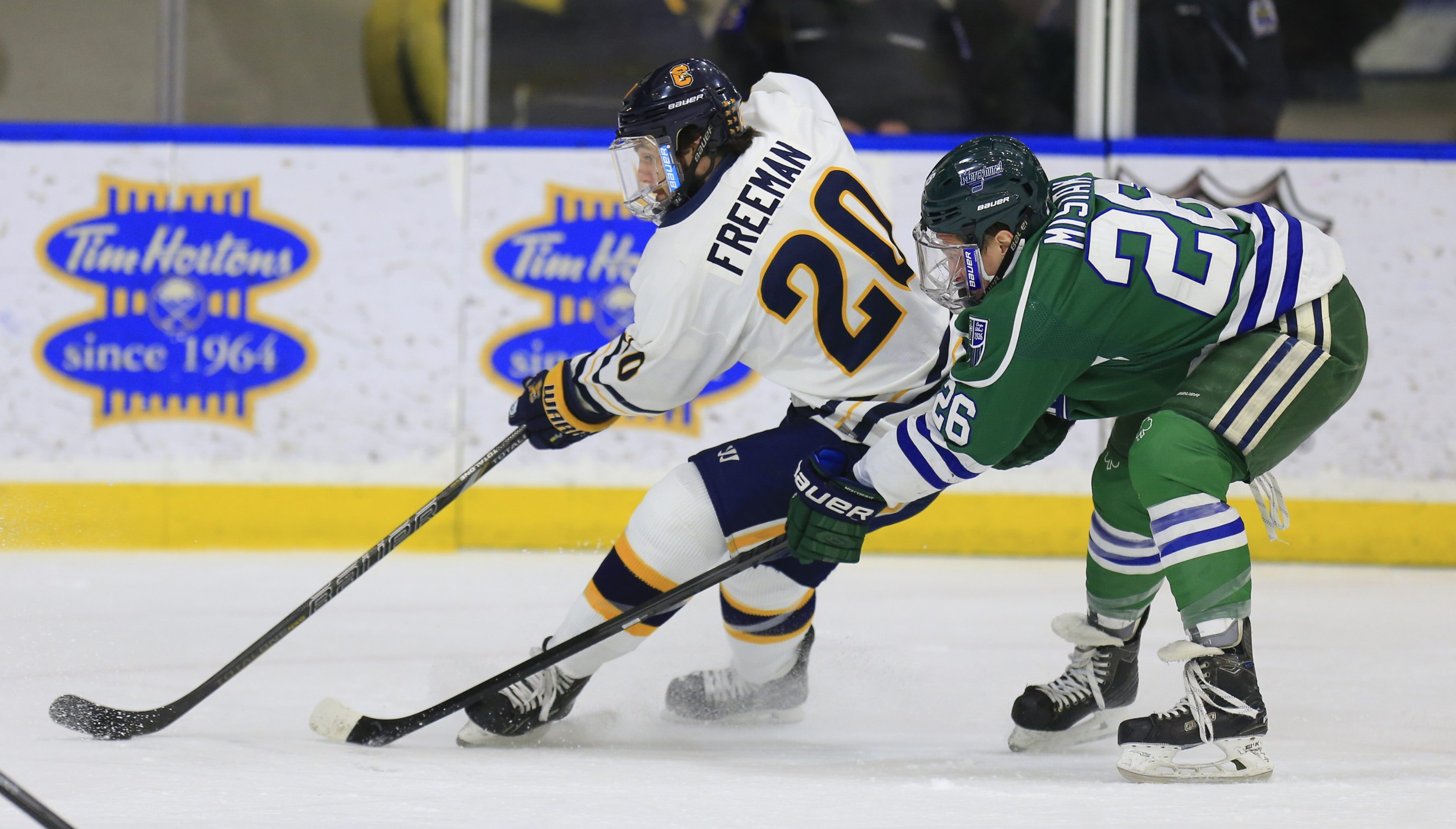 Canisius' Cody Freeman (20) skates past Mercyhurst player Ryan Misiak (26) during first period action at the HarborCenter center  on Saturday, Feb. 21, 2015.(Harry Scull Jr./Buffalo News)
