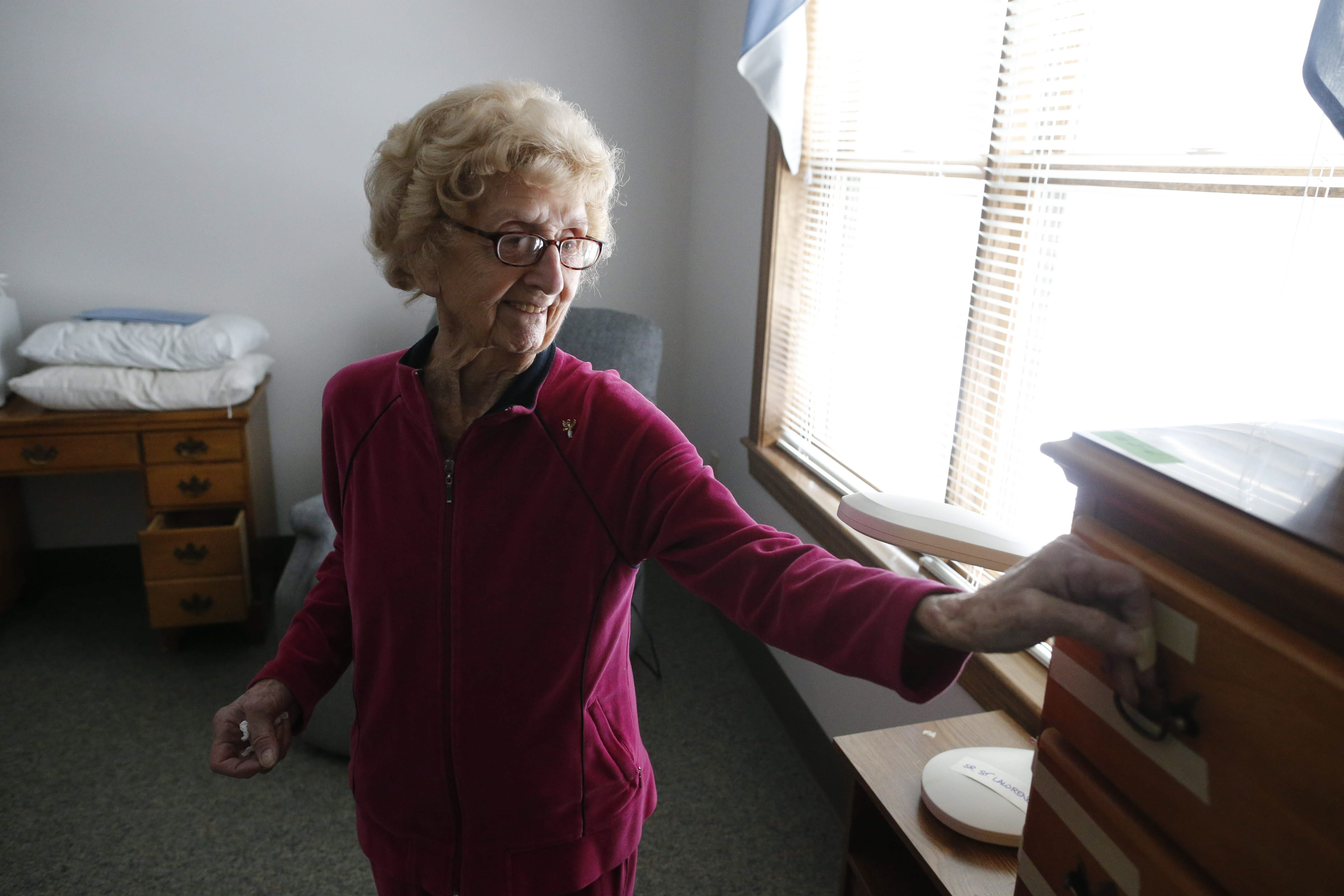 """Sister St. Lawrence, 99, starts to organize as movers fill her new room with her belongings at the new residence for Sisters of St. Mary of Namur on Lafayette Avenue near Grant Street on Wednesday, March 11, 2015.  Many sisters are returning after moving away for the construction of a sizable addition to the convent.  """"Saint,"""" as she is called by her sisters, spent the time away in Lockport.  (Derek Gee/Buffalo News)"""
