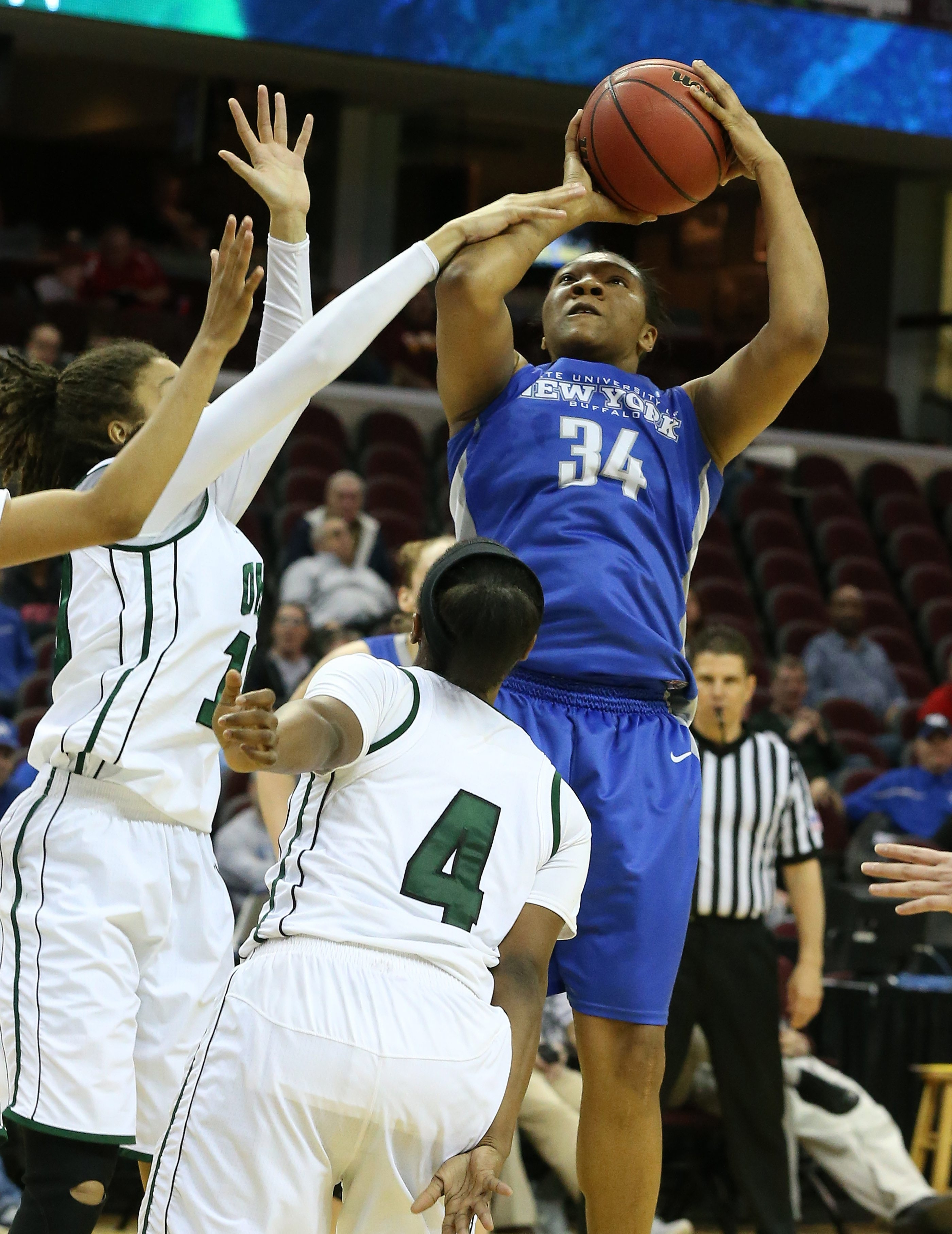 Alexus Malone (34) of UB scores over Ohio's Kiyanna Black in Friday's game at Quicken Loans Arena in Cleveland.