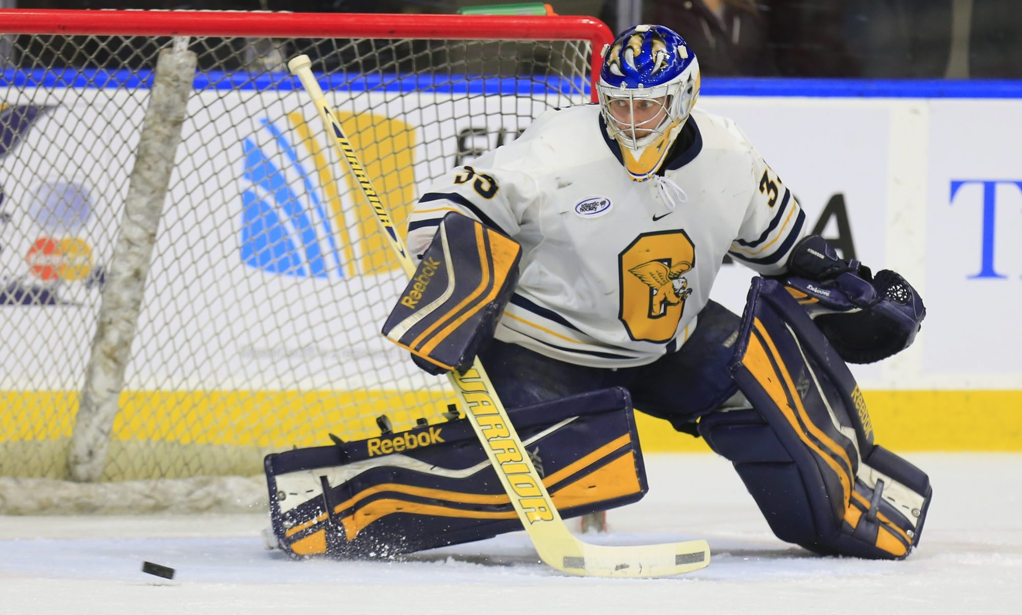 Canisius goaltender Keegan Asmundson makes a save against Sacred Heart during second period action at HarborCenter on Friday.