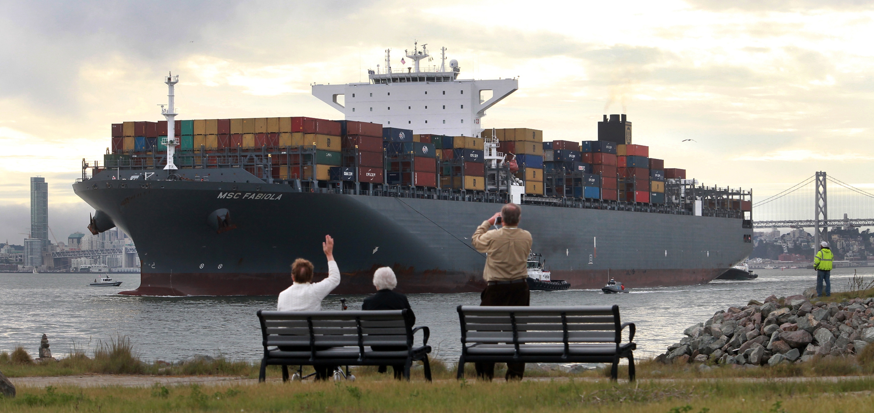 Spectators line the shores of the Oakland Alameda Estuary at Middle Harbor Shoreline Park in Oakland, Calif., to watch the MSC Fabiola container ship make its way to the dock at the Port of Oakland. (Laura A. Oda/Bay Area News Group/TNS)
