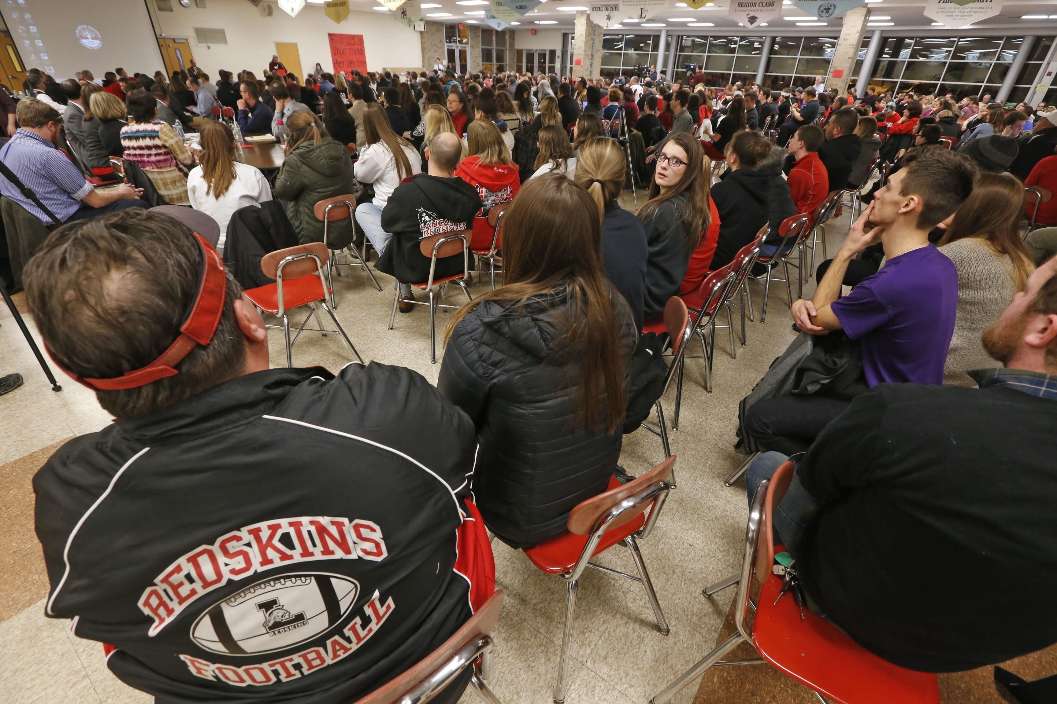 Community members on both sides of Lancaster's nickname debate fill the Lancaster High School cafeteria during a community engagement session on March 3.