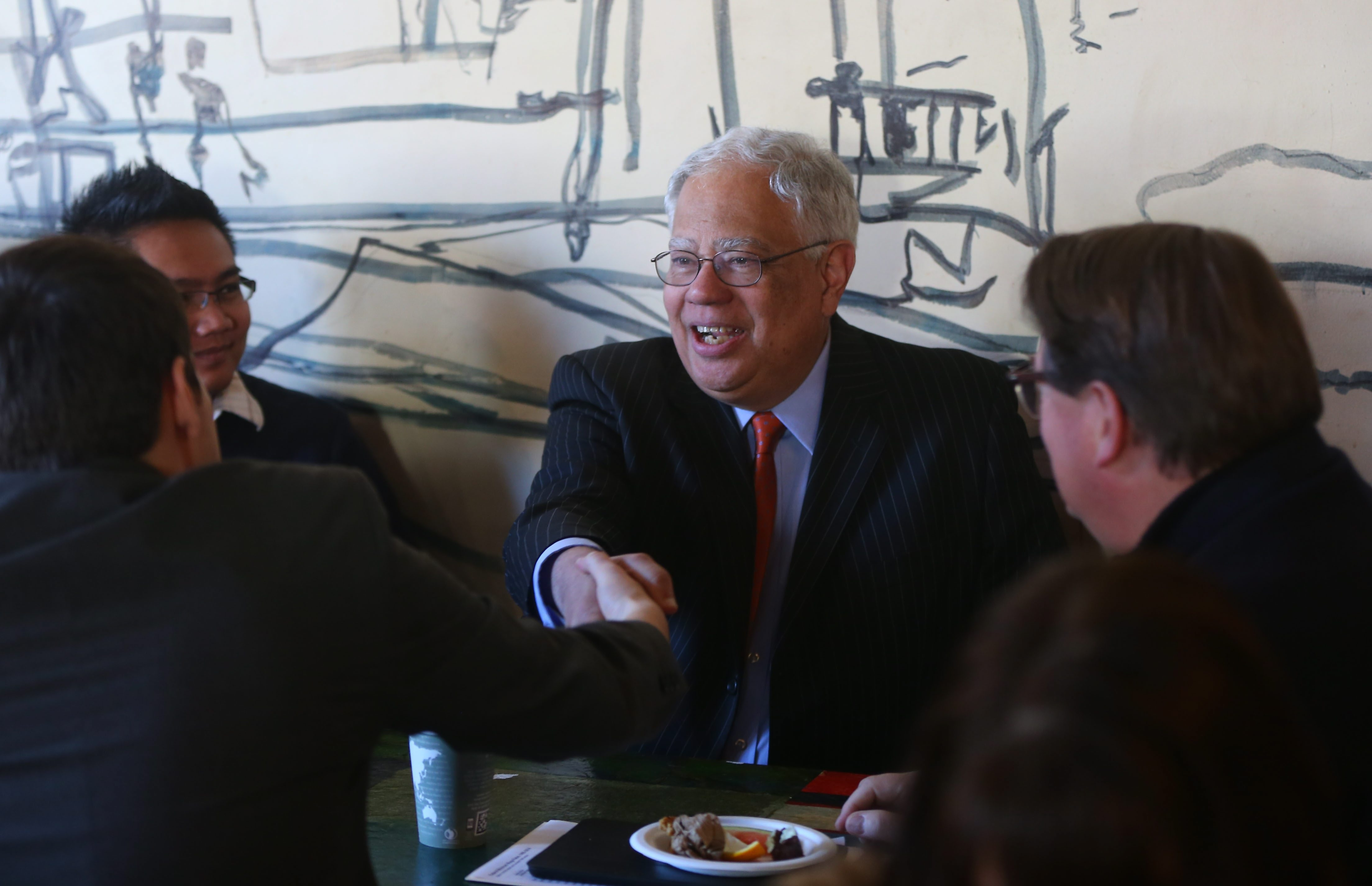 Secretary of State Cesar Perales discusses the minimum wage proposal at Sweet_ness 7 Café in Buffalo.