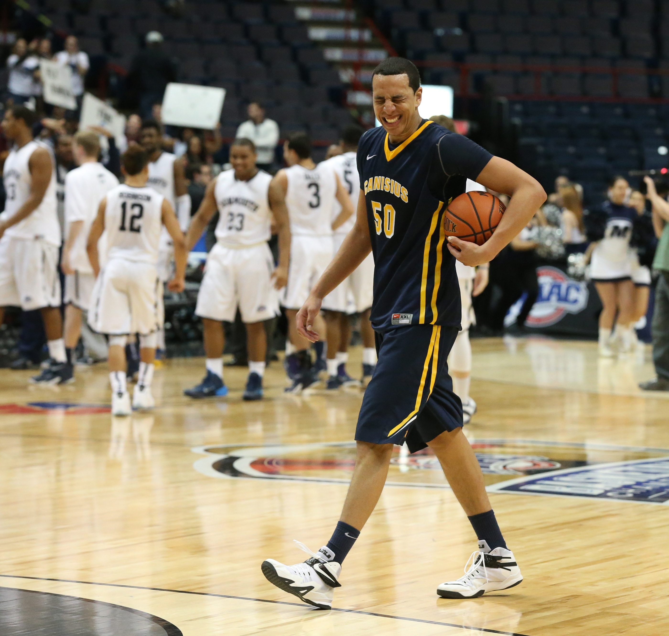 Canisius forward Josiah Heath walks off the court after his final game.