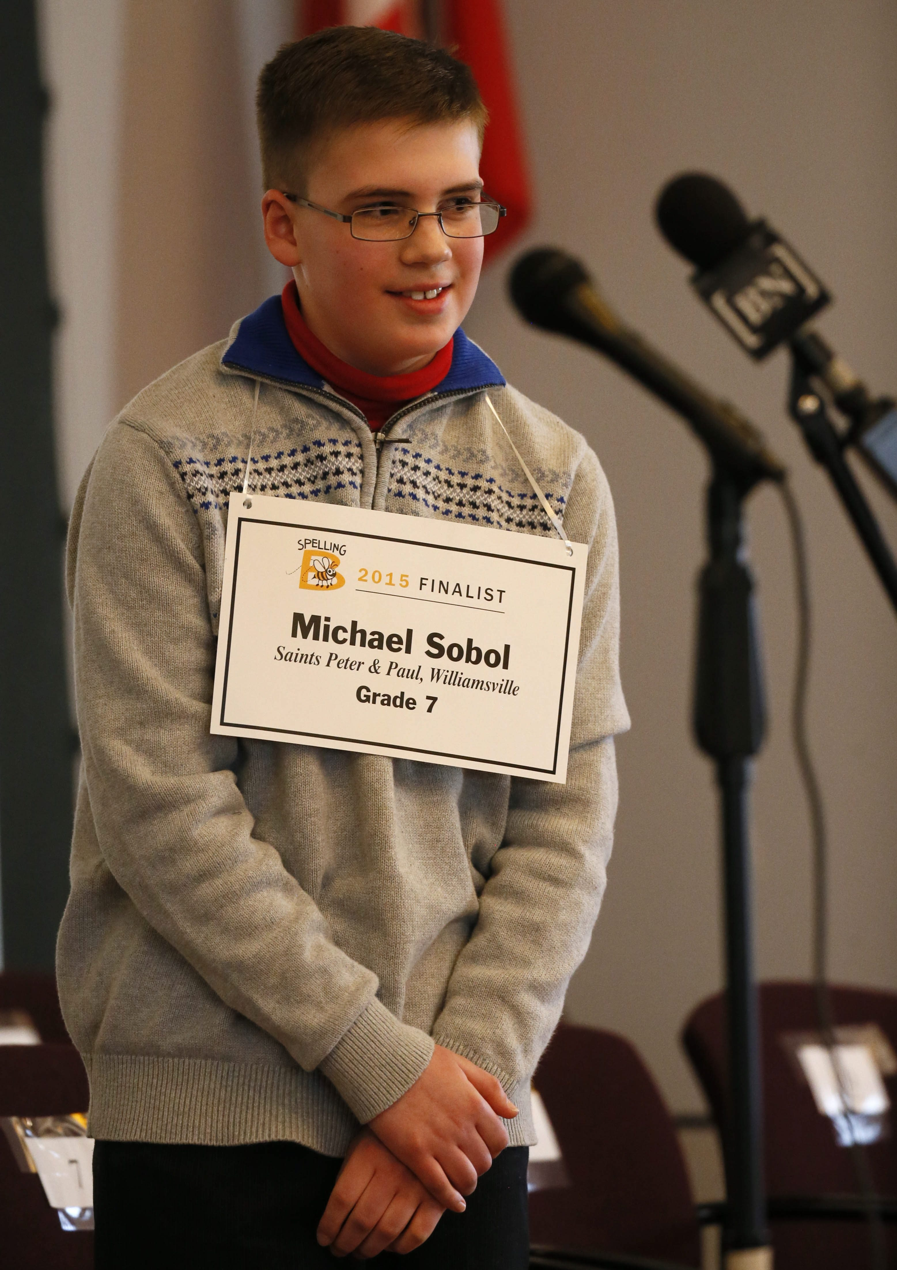 Michael Sobol, a seventh-grade student at SS. Peter & Paul School in Williams- ville, spells the winning word in The Buffalo News Spelling Bee on Sunday.