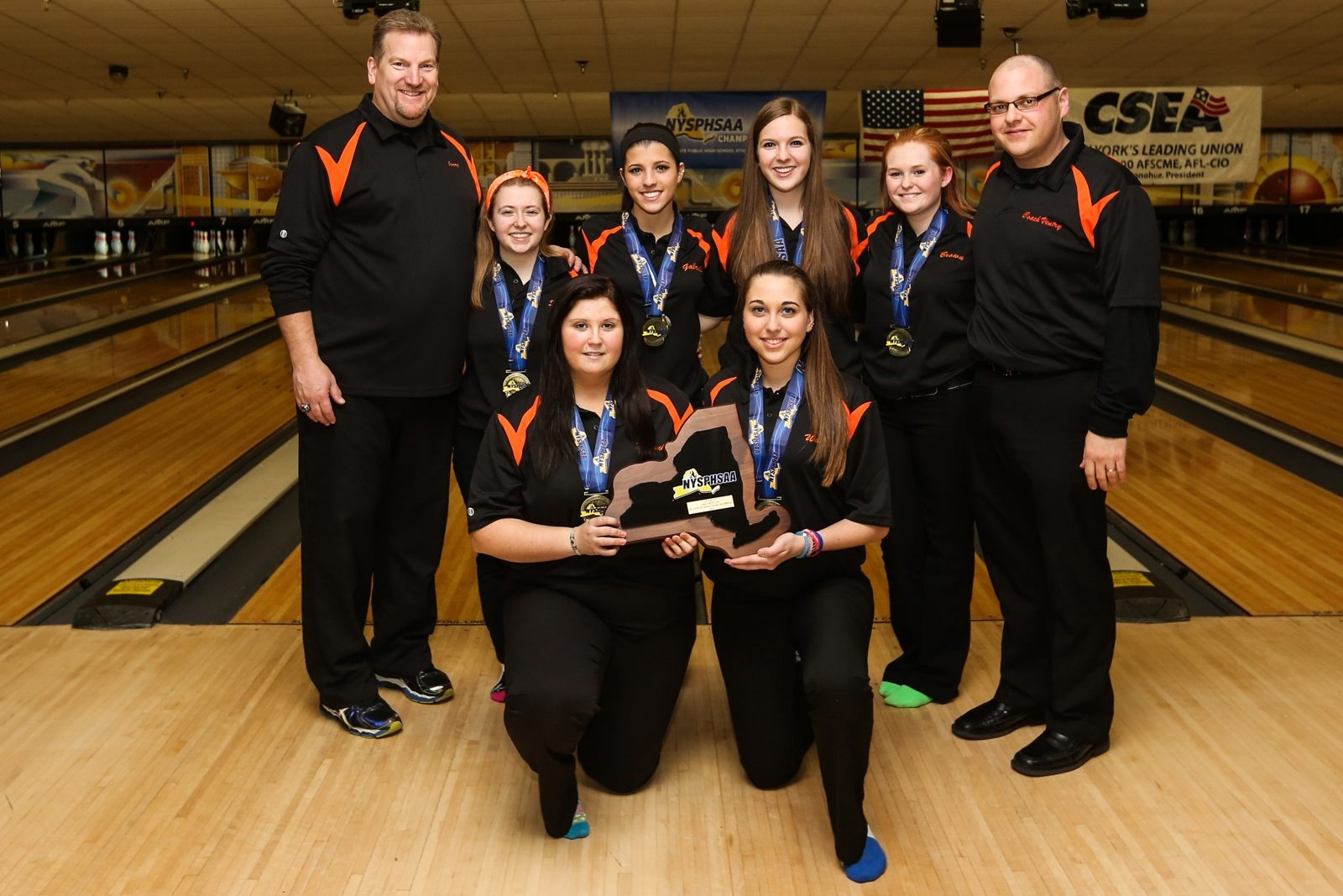 Section VI coach Jerry Carroll, left,  and assistant Ed Ventry flank  back row, from left Sara Snyder (Depew), Angela Gabriele (Niagara Falls), Haley Carroll ( Williamsville South) and Julia Brown (Niagara-Wheatfield). Front row, from left, Lauren Pieroni (Lockport) and  Alexis Wade (Lewiston-Porter).