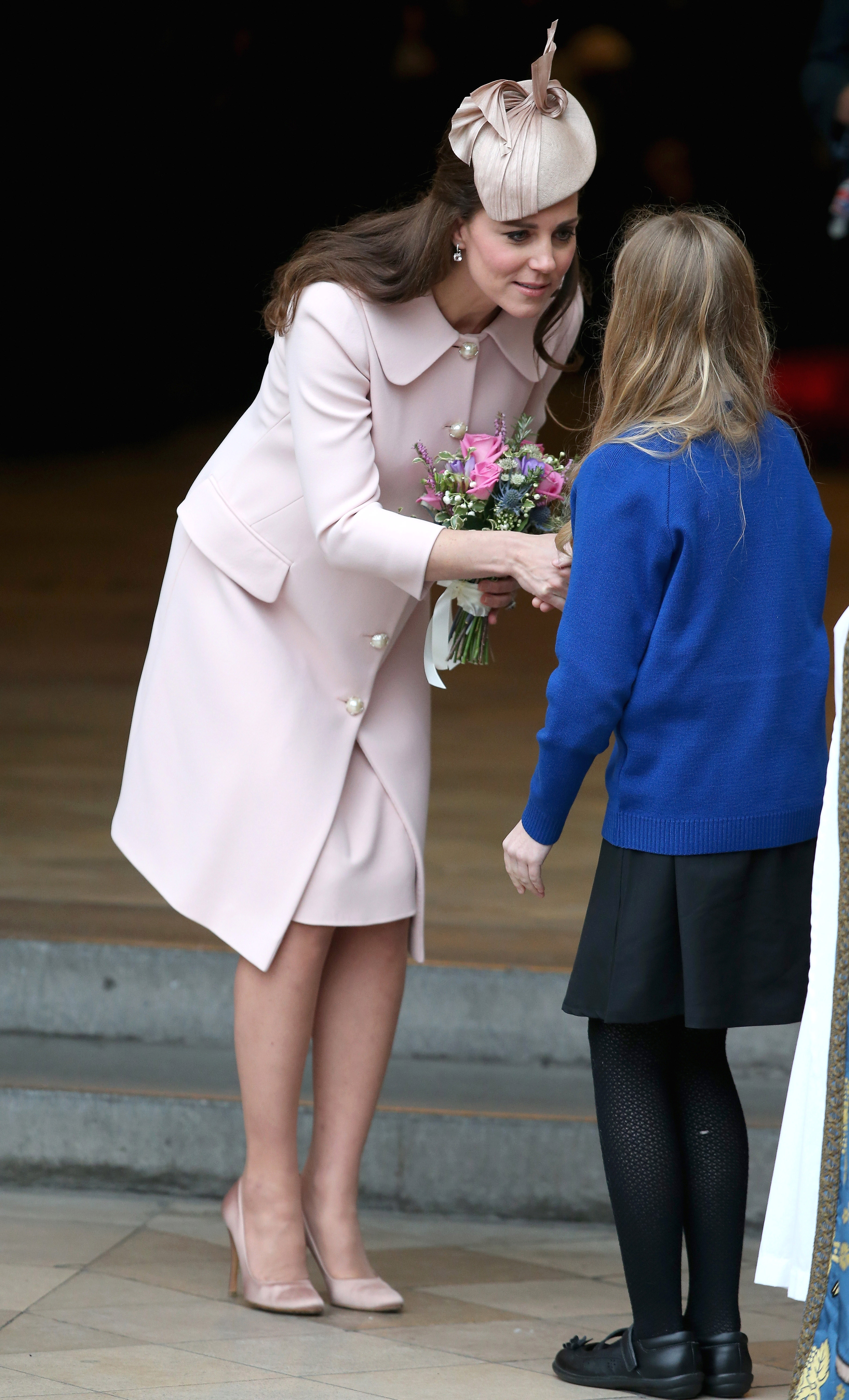 Catherine, Duchess of Cambridge, leaves the Observance for Commonwealth Day Service at Westminster Abbey.