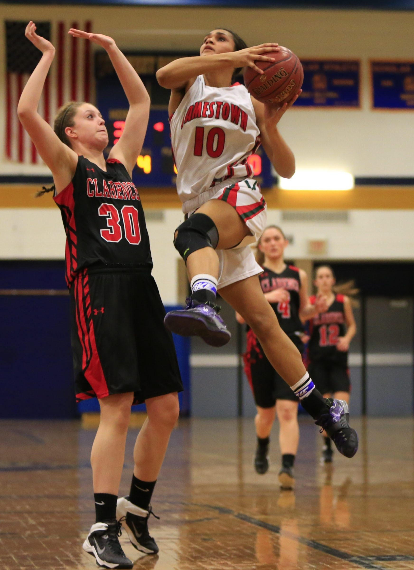 Harry Scull Jr./Buffalo News  Jamestown's Chrisanna Green drives past Clarence's Carly Reynolds during second half playoff action at Sweet Home high school  on Friday, March 6, 2015.()