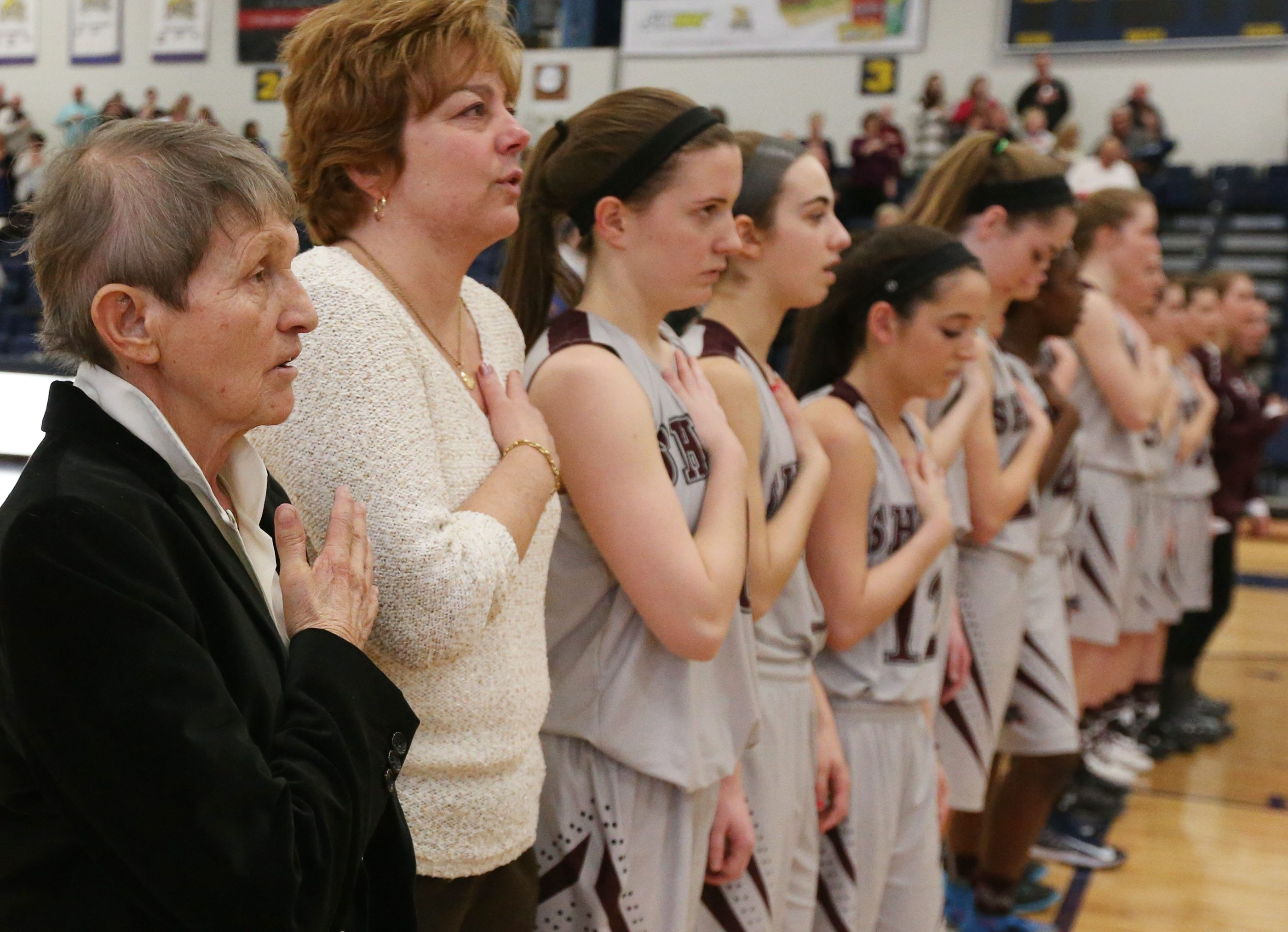 Sacred Heart coach Sister Maria Pares, left, has been let go by the school after a five-decade career.