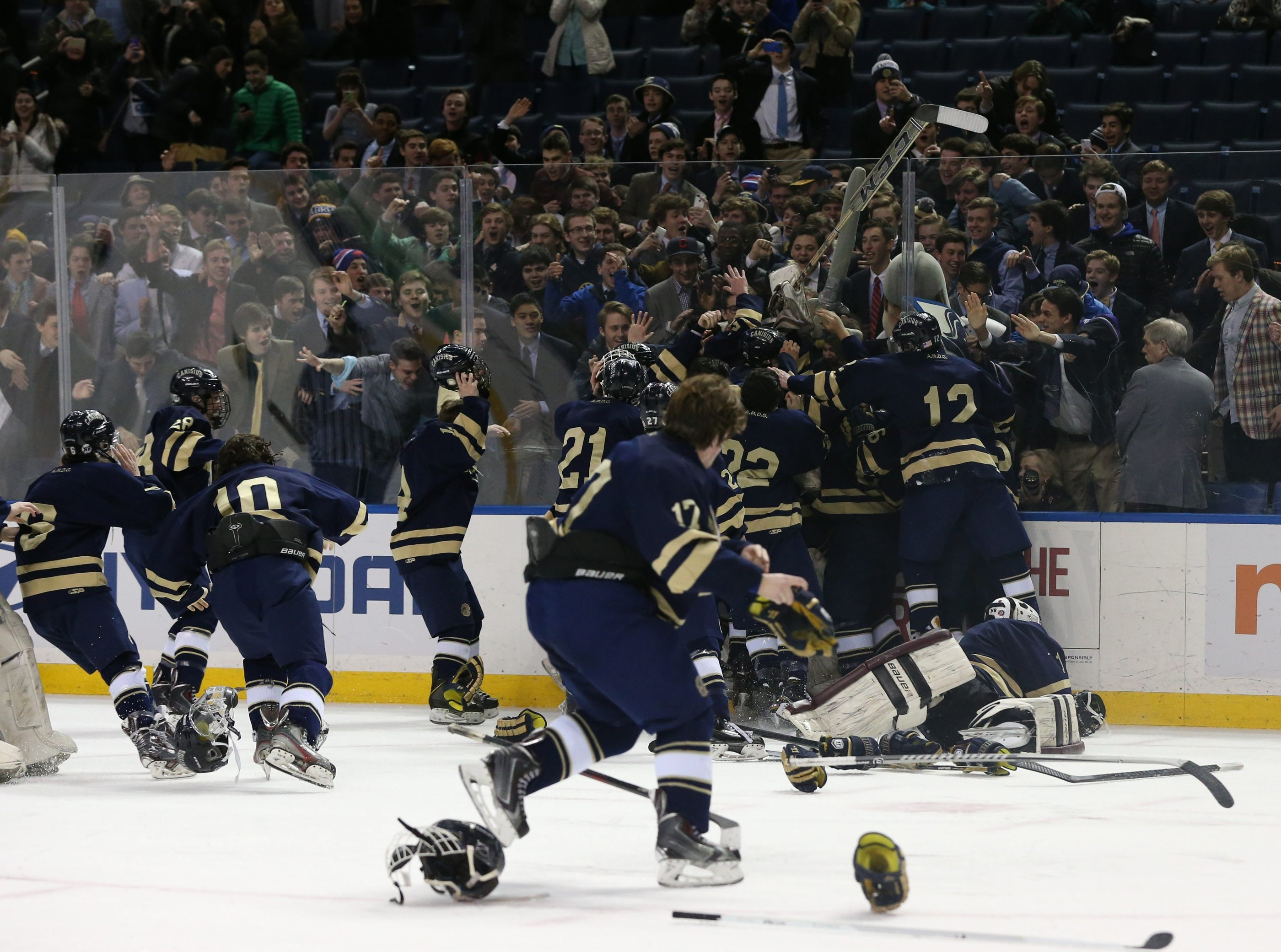 Canisius celebrates its win over St. Joe's as it claims the Niagara Cup championship at First Niagara Center.
