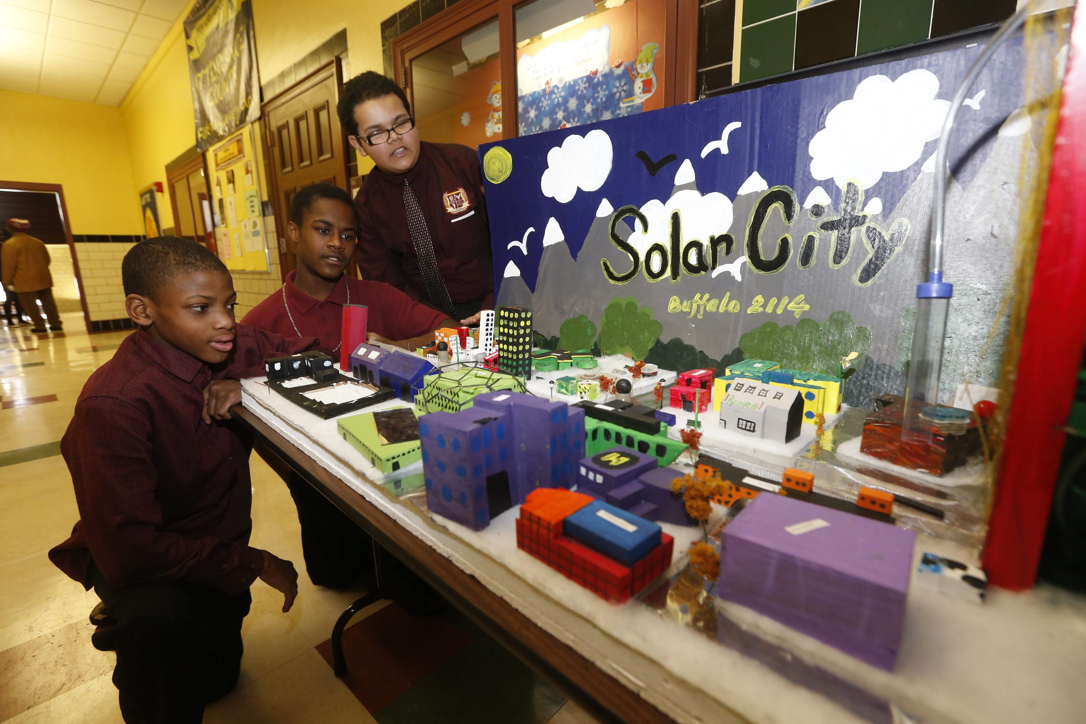 From left, Antonio Haley, 13, Steven Small, 13, and Romeo Anthony, 14, give a tour of their Solar City Buffalo project at Marva J. Daniel Futures Preparatory School at 295 Carlton St. on Thursday. The school was one of 11 chosen to pilot a new curriculum.