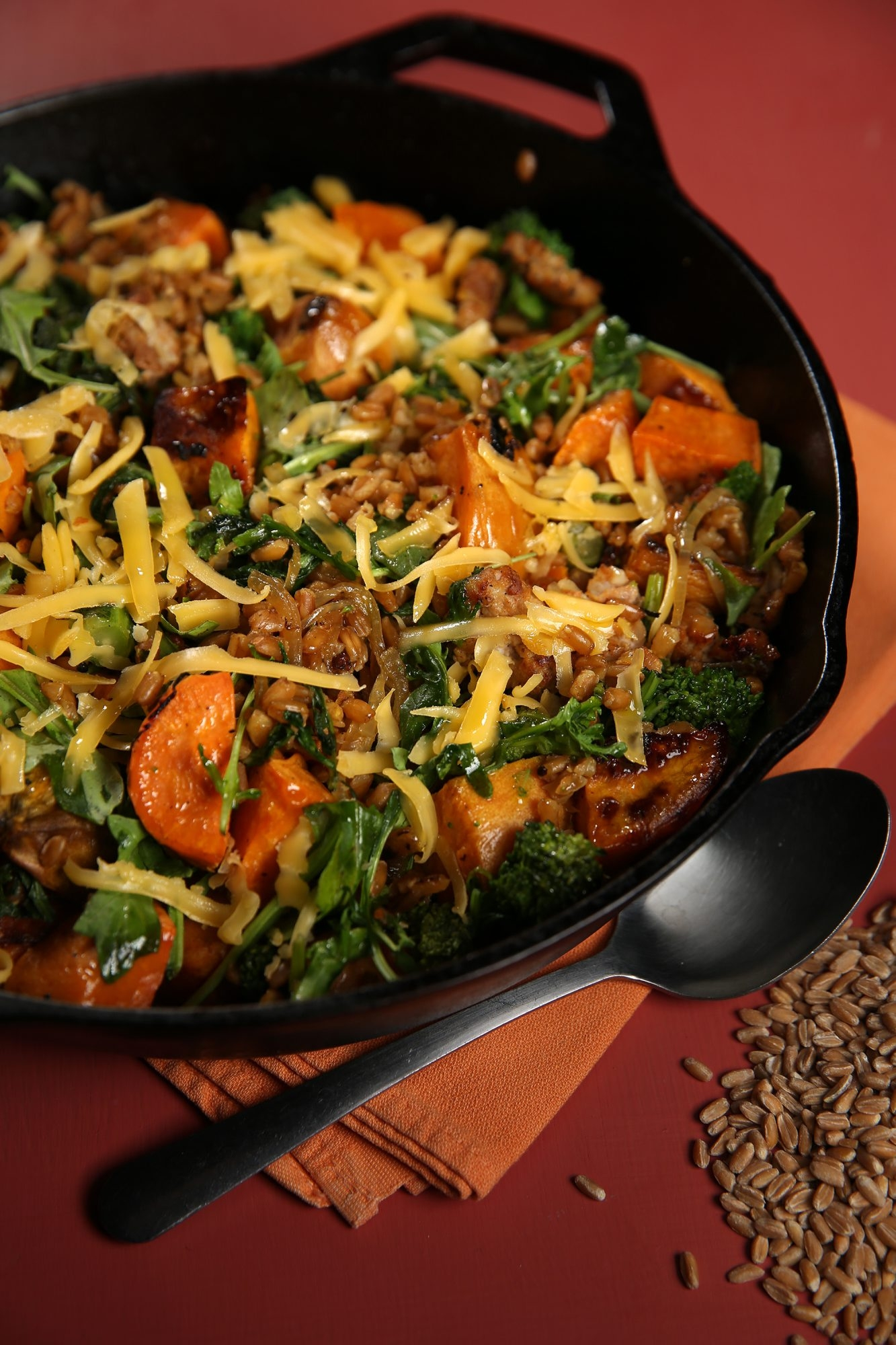 A farro-based recipe gets support from roasted sweet potatoes, broccoli rabe, cheese and Italian sausage.