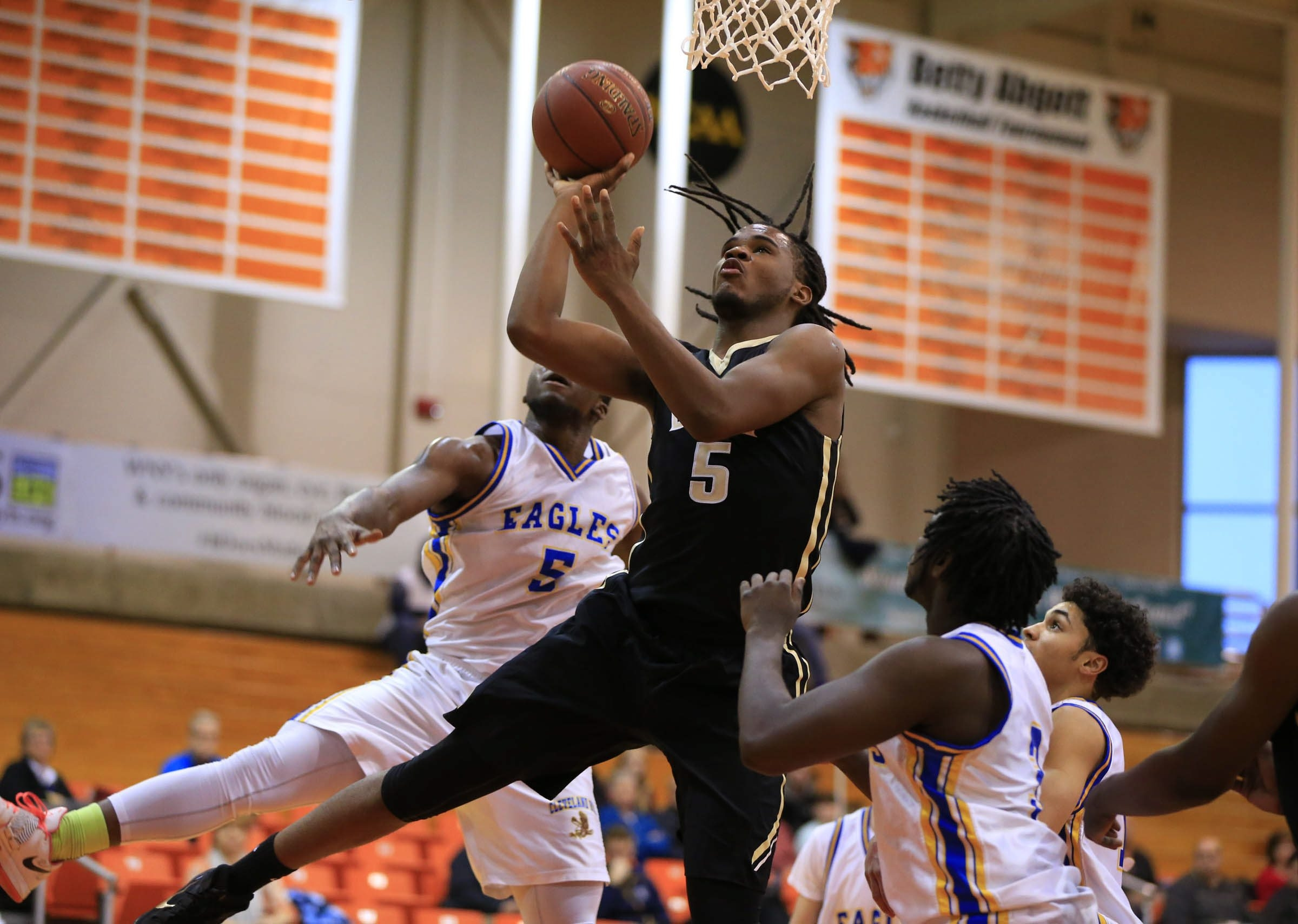 East's Jovell Littlejohn shoots over Cleveland Hill's Jermaine Hairston during the first half Tuesday at Buffalo State. East advanced to its sixth title game in a row, 59-44.