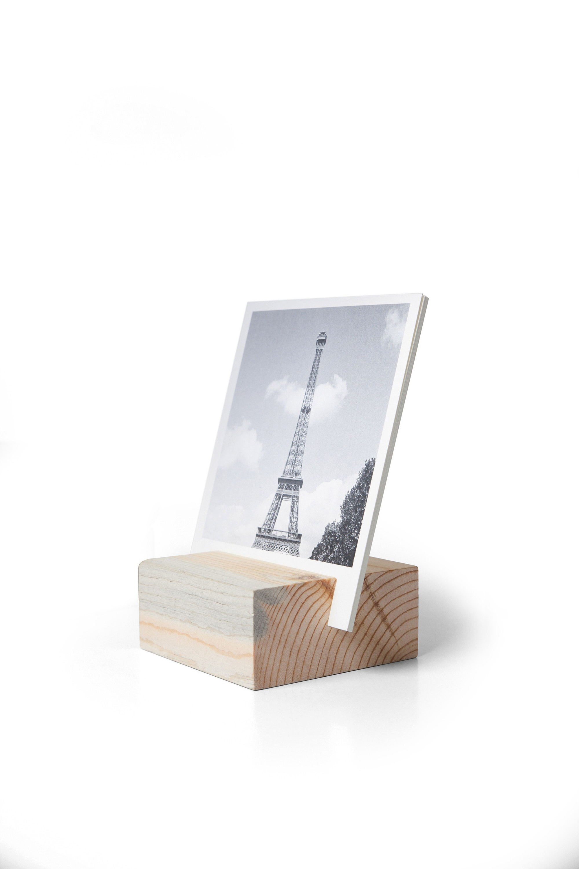 This sophisticated wood block was handcrafted in Colorado from mountain beetle pine reclaimed from fallen wastewood in the forests. Creating a rotating display of 12 textured paper prints in the block. $23.99 at artifactuprising.com. (artifactuprising.com/Chicago Tribune/TNS)