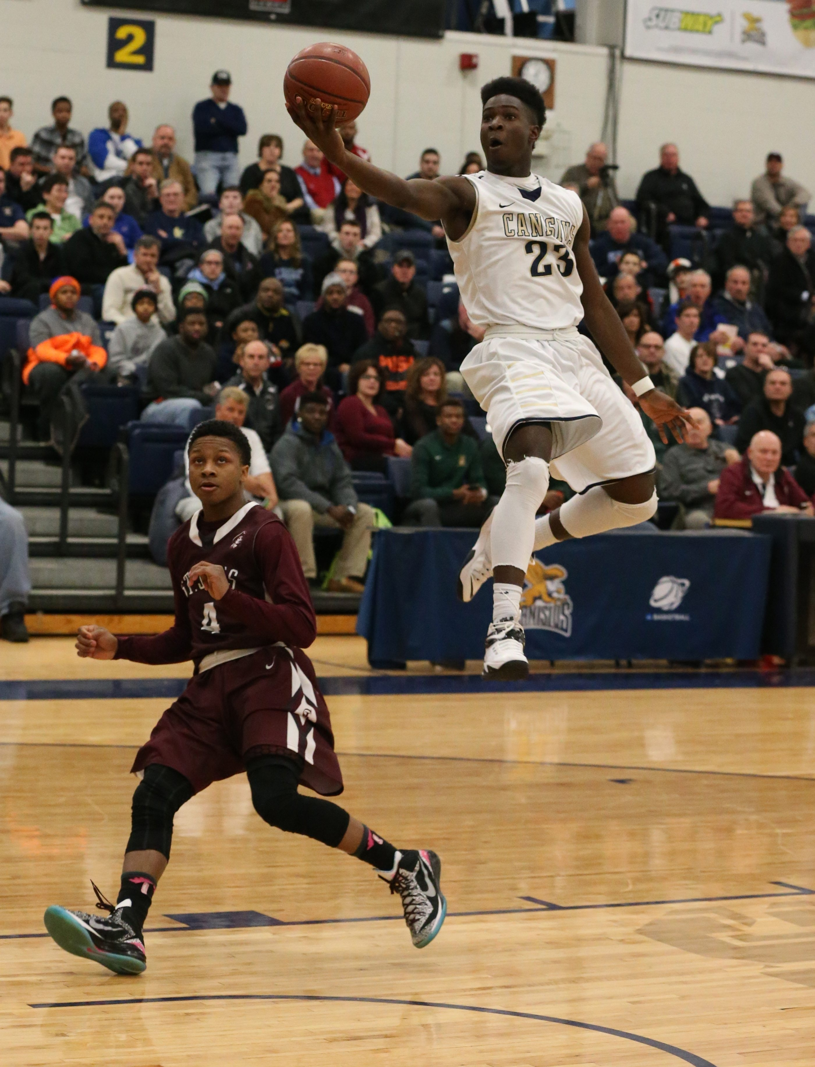 LaTerrance Reed of Canisius swoops in for two points over St. Joe's  Naseer Jackson.