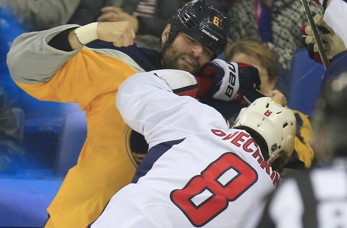 Sabres defenseman Mike Weber throws a punch at Capitals' star Alex Ovechkin during first period action on Monday. (Harry Scull Jr./Buffalo News)
