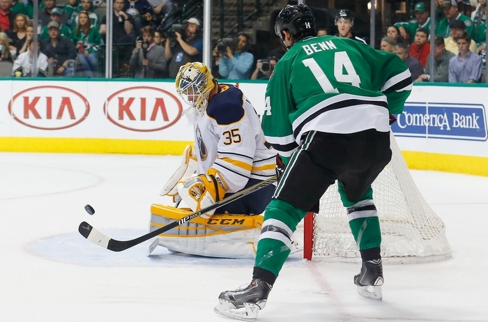 Sabres goalie Anders Lindback isn't distracted by the presence of Jamie Benn of the Stars during Monday night's game in Dallas. (Getty Images)