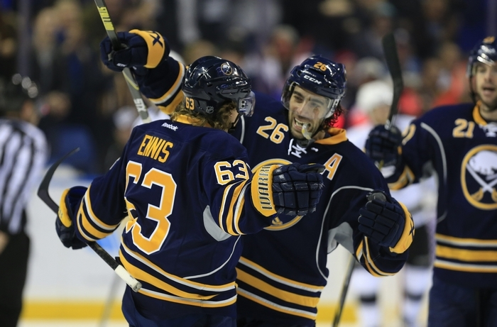 Buffalo Sabre Tyler Ennis (63) celebrates with Matt  Moulson after Ennis scored on Los Angeles Kings  goaltender Jonathan Quick (32)  during third period action at the First Niagara Center on Tuesday, Dec. 9, 2014. The Sabres defeated the Kings 1-0.(Harry Scull Jr./Buffalo News)