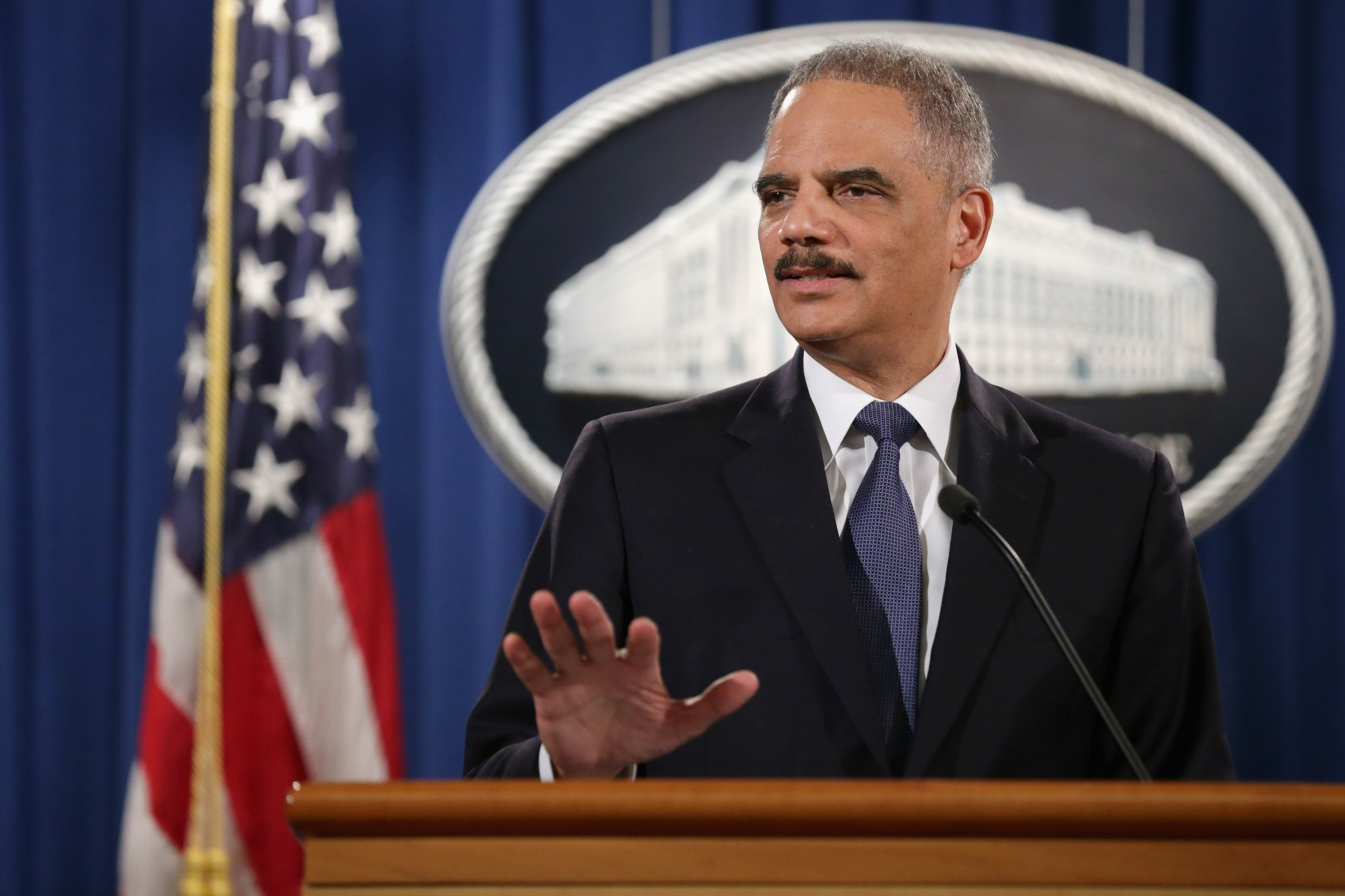 Attorney General Eric Holder delivers remarks about the Justice Department's findings related to two investigations in Ferguson, Missouri, at the Robert F. Kennedy Department of Justice Building March 4, 2015 in Washington, DC.  (Getty Images)