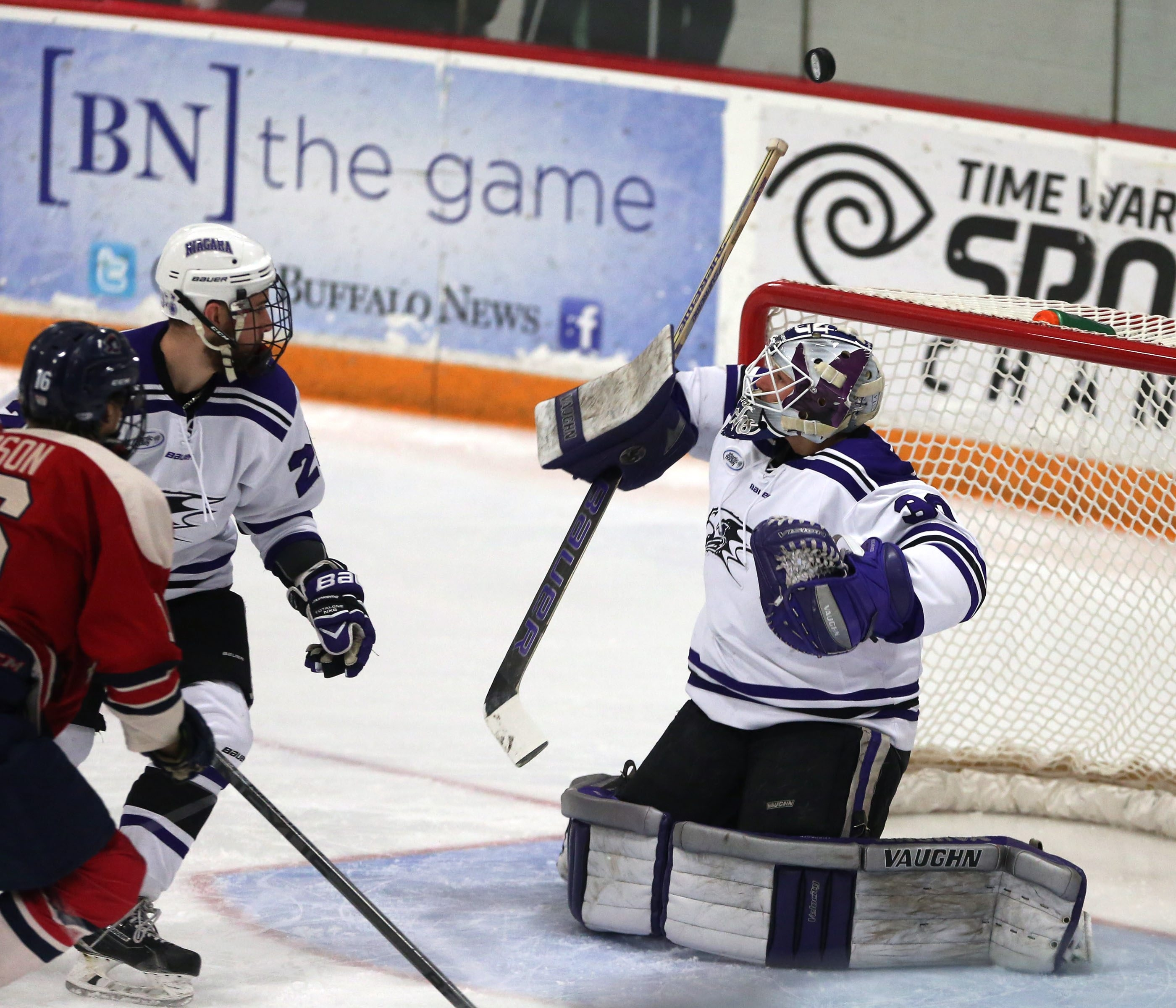 Niagara University's Jackson Teichroeb makes a save against Robert Morris's Greg Gibson in the first period at Dwyer Arena in Niagara University,N.Y. on Friday, Feb. 27, 2015.  (James P. McCoy/ Buffalo News)