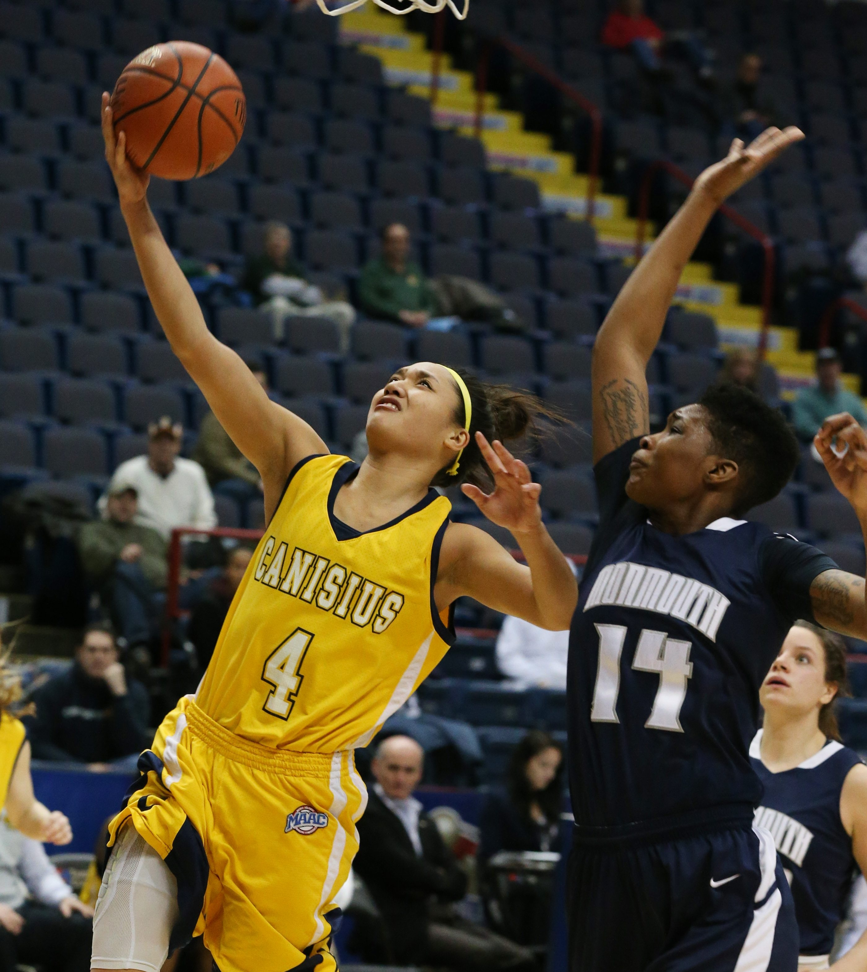 Canisius guard Kayla Hoohuli goes up for a basket against Monmouth's Christina Mitchell in the second half.