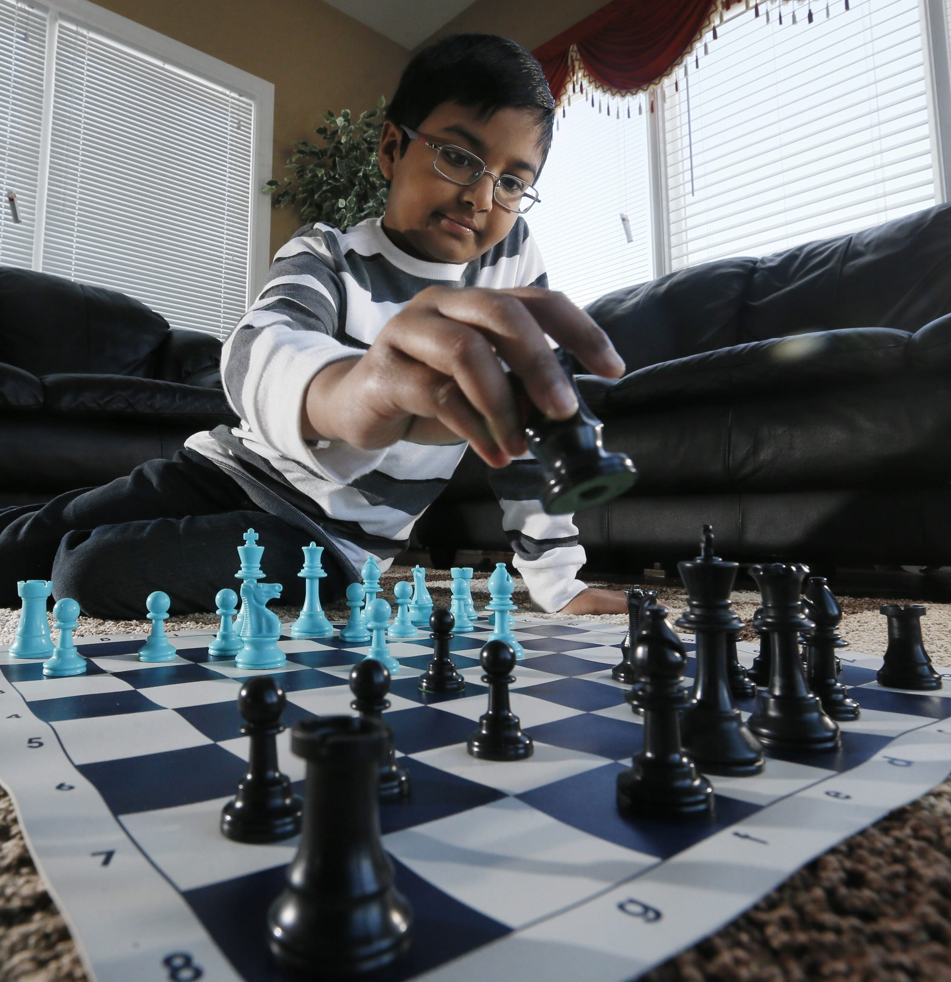 Ashton William, 9, of Amherst, beat 150 other kids in his age group to win the 48th Annual New York Chess Championship in Saratoga Springs earlier this month.