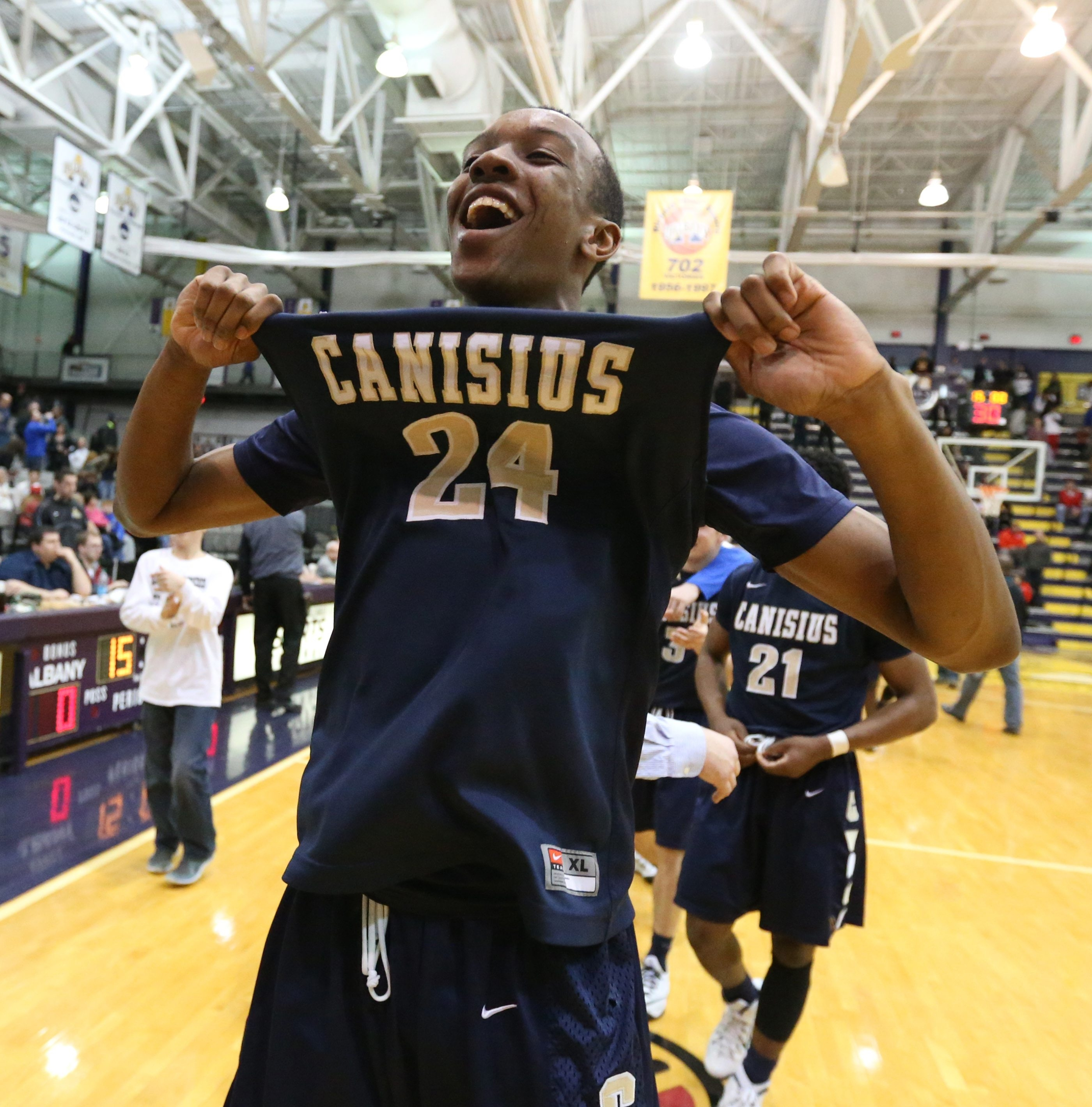 Canisius' Stafford Trueheart celebrates after the Crusaders won the NYS Federation Tournament of Champions on Saturday.