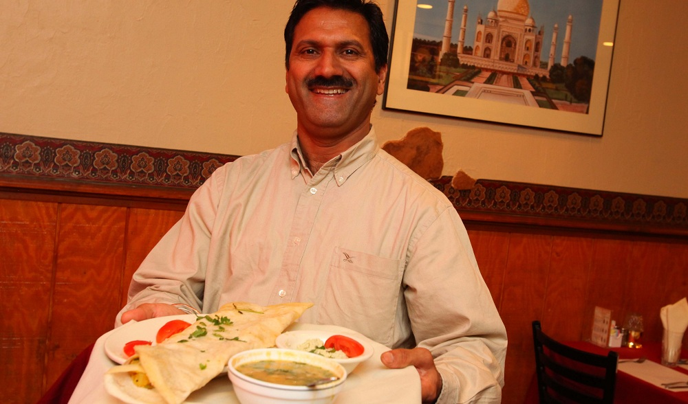Taste of India owner Deep Singh will move his restaurant across the street. (Buffalo News file photo)