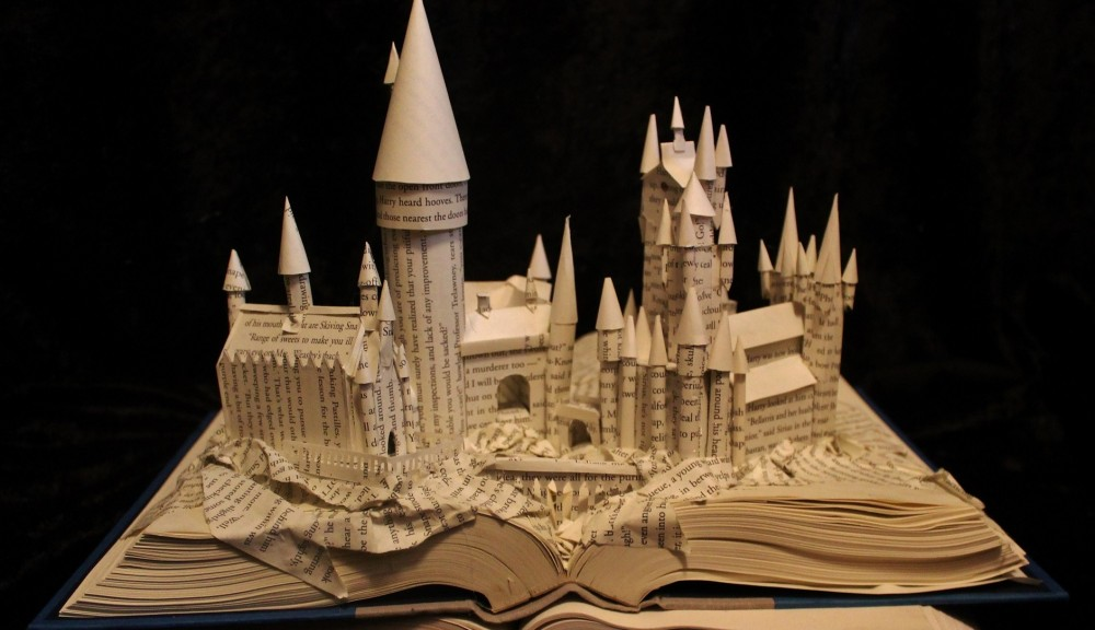 'Hogwarts,' a book-based sculpture by Jodi Harvey-Brown, is on view in Kenan Center's exhibition 'Wood, Paper, Scissors.'